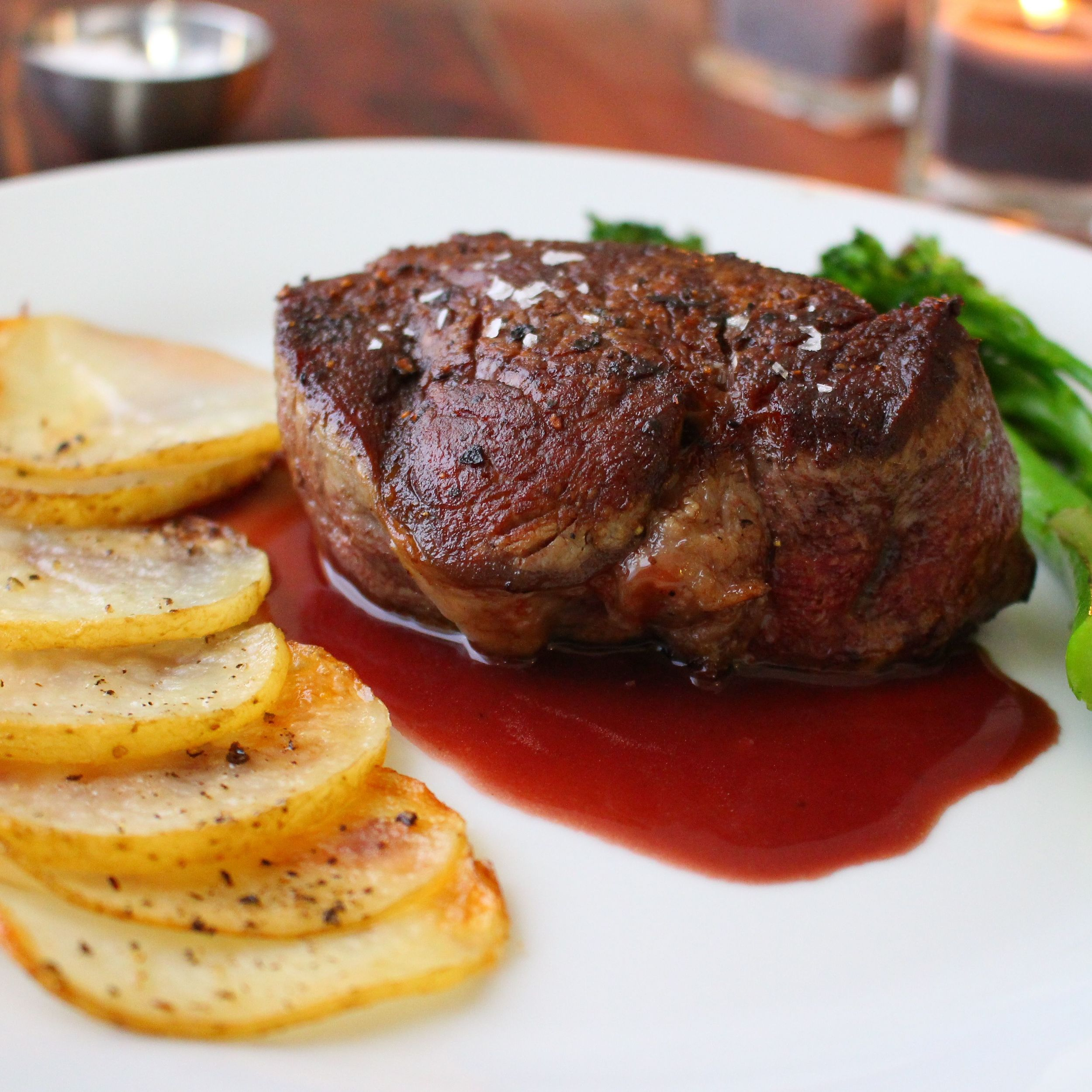 Filet mignon, red wine reduction, potatoes and broccolini