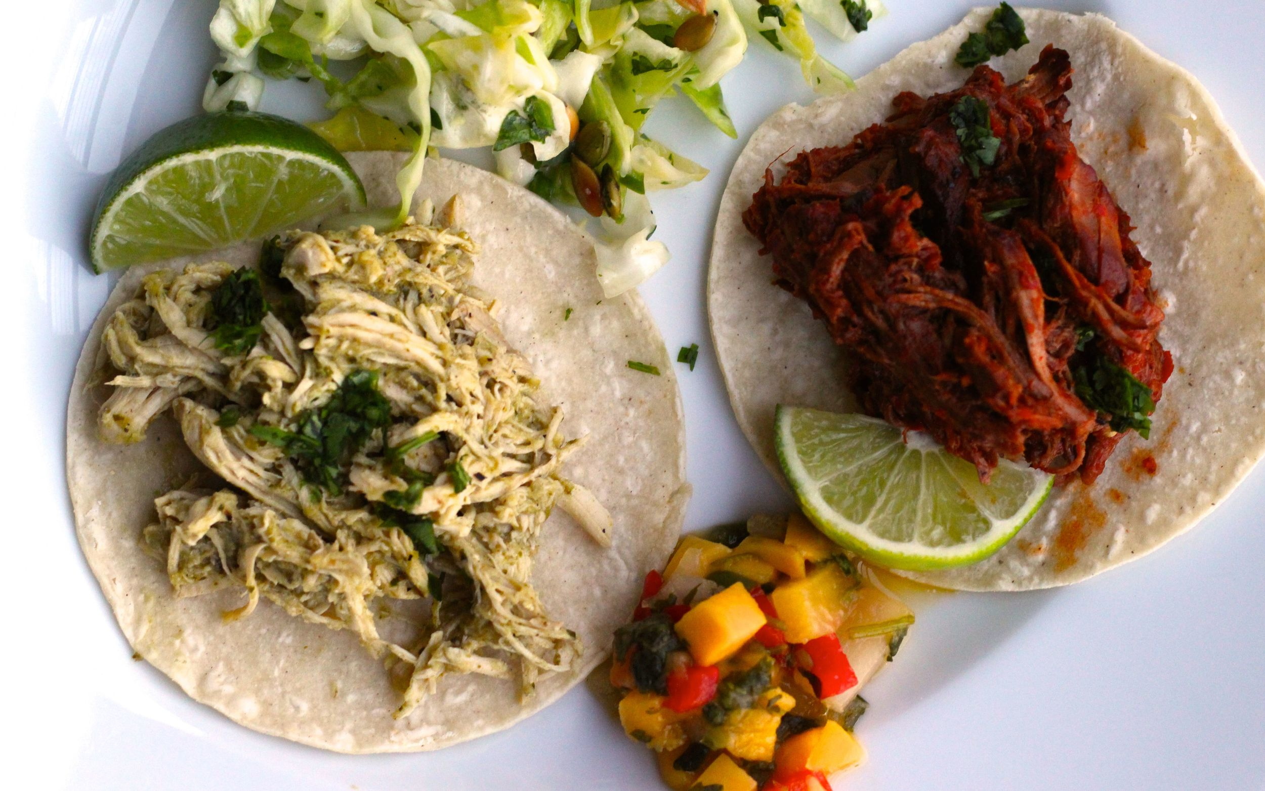 Chicken tacos in green chile sauce and beef tacos in red chile sauce