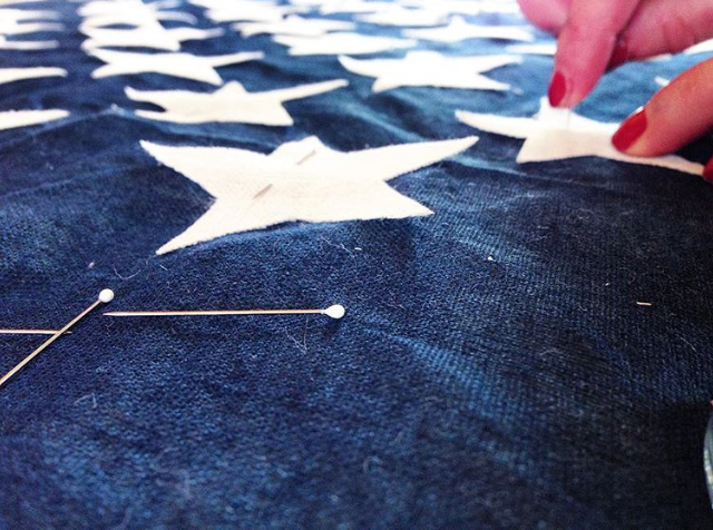 Carefully laying each star into place -