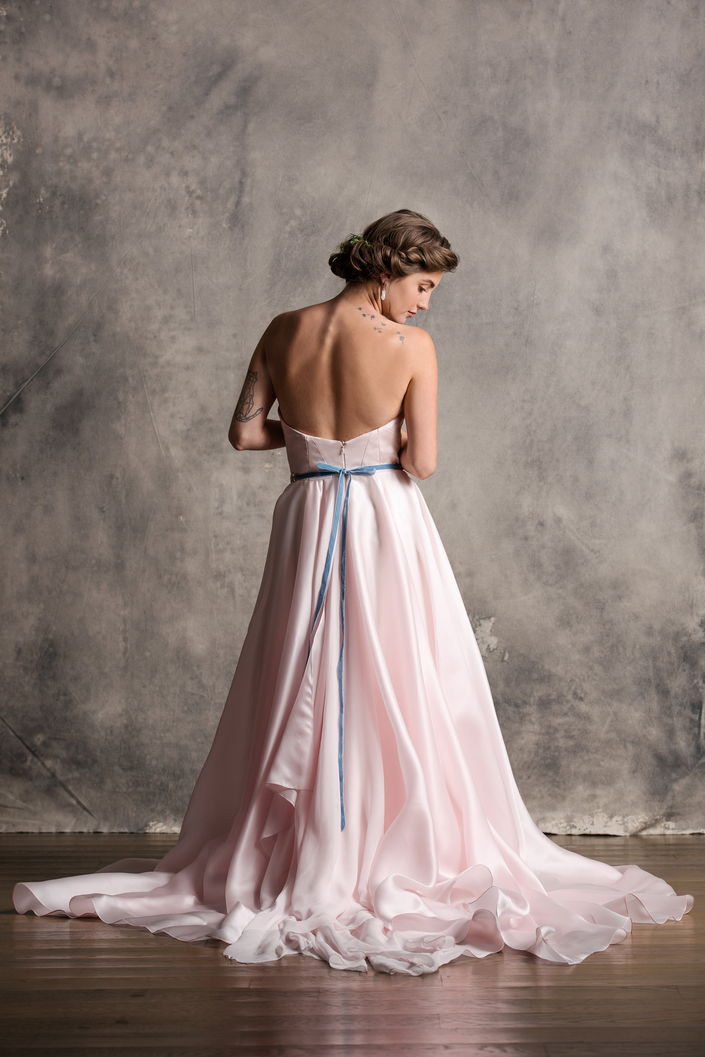 Aurora - Named after the Aurora Borealis with a skirt that flows with such grace. Her bodice is composed with seams that build structure and is softened with a subtle sweetheart neckline.In norse mythology, The Aurora Borealis is believed to be the stars reflection against the armor of the Valkyries.
