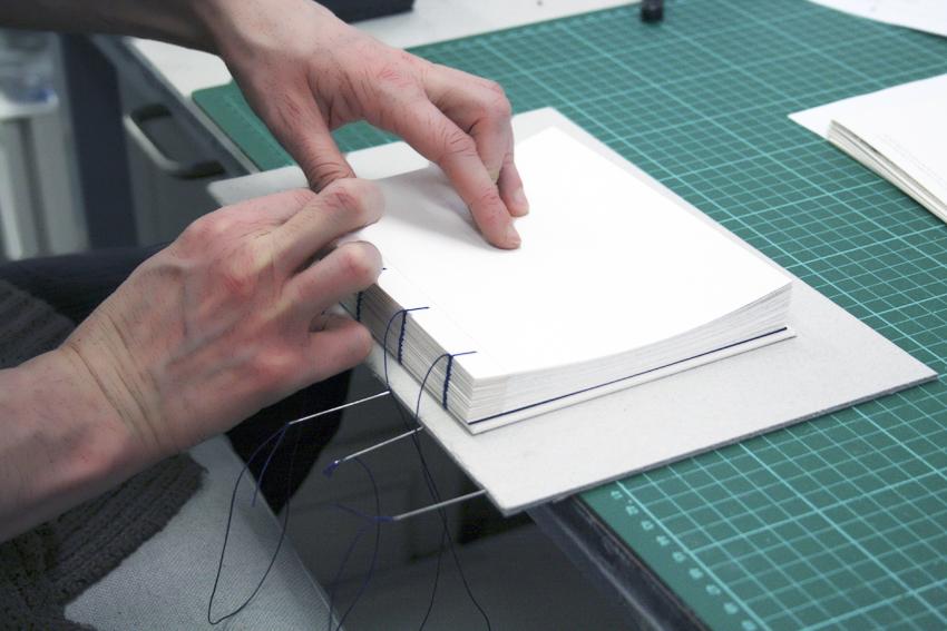 Stitching a coptic binding.JPG