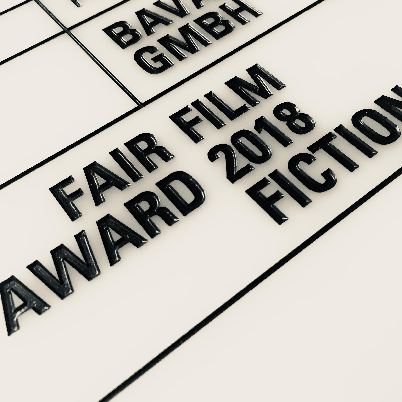 Film- bzw. Schnappsklappe als Trophäe für die Gewinner