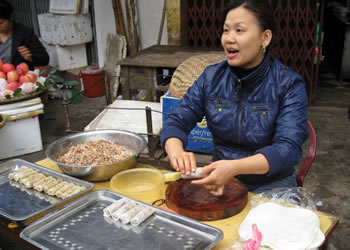 making spring rolls in open market