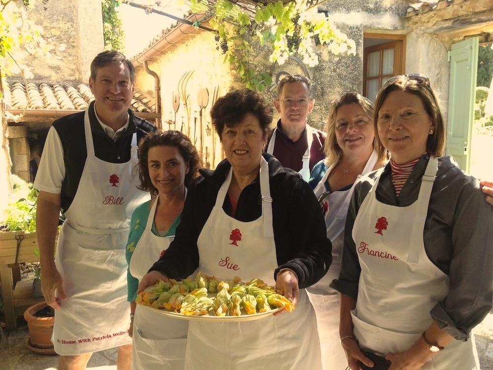 Students with stuffed zucchini flowers.JPG