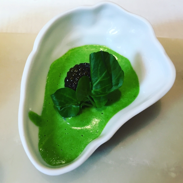 Poached oysters in watercress sauce and caviar