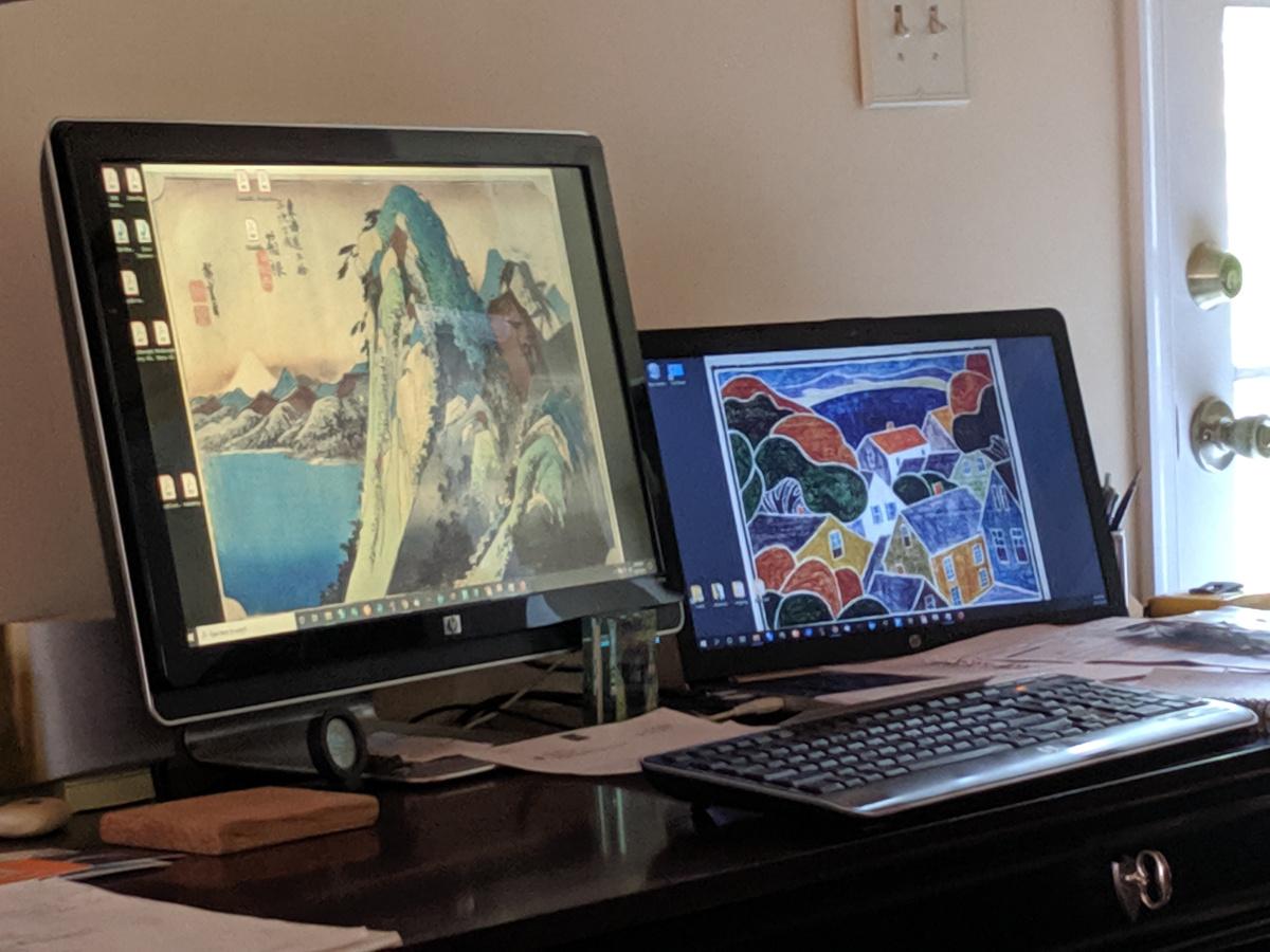 my desk; screen saver rotating thru my favorite block prints