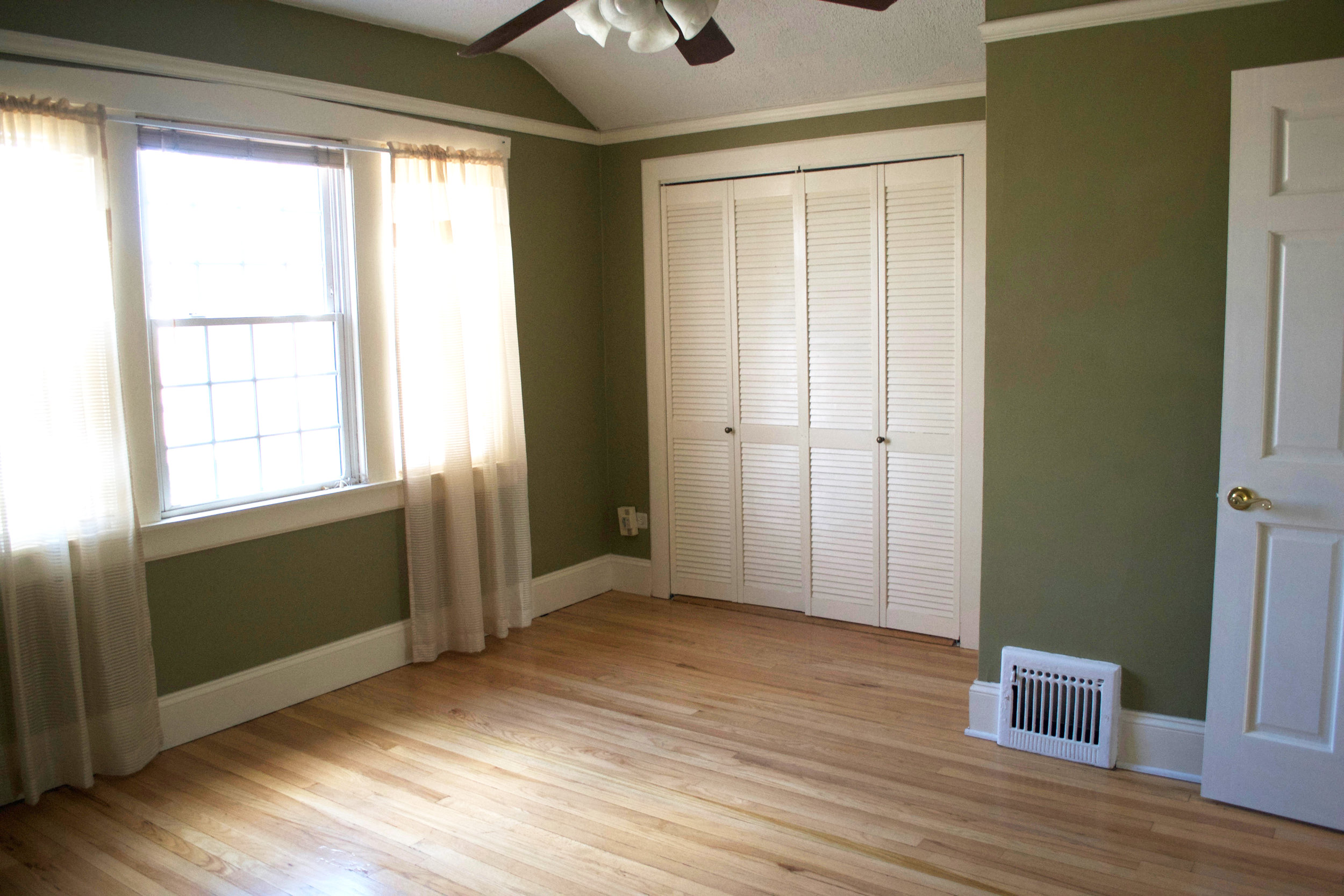 We removed the popcorn ceiling and the awkward trim, as well as painted the walls and replaced the doorknob, ceiling fan, and window coverings