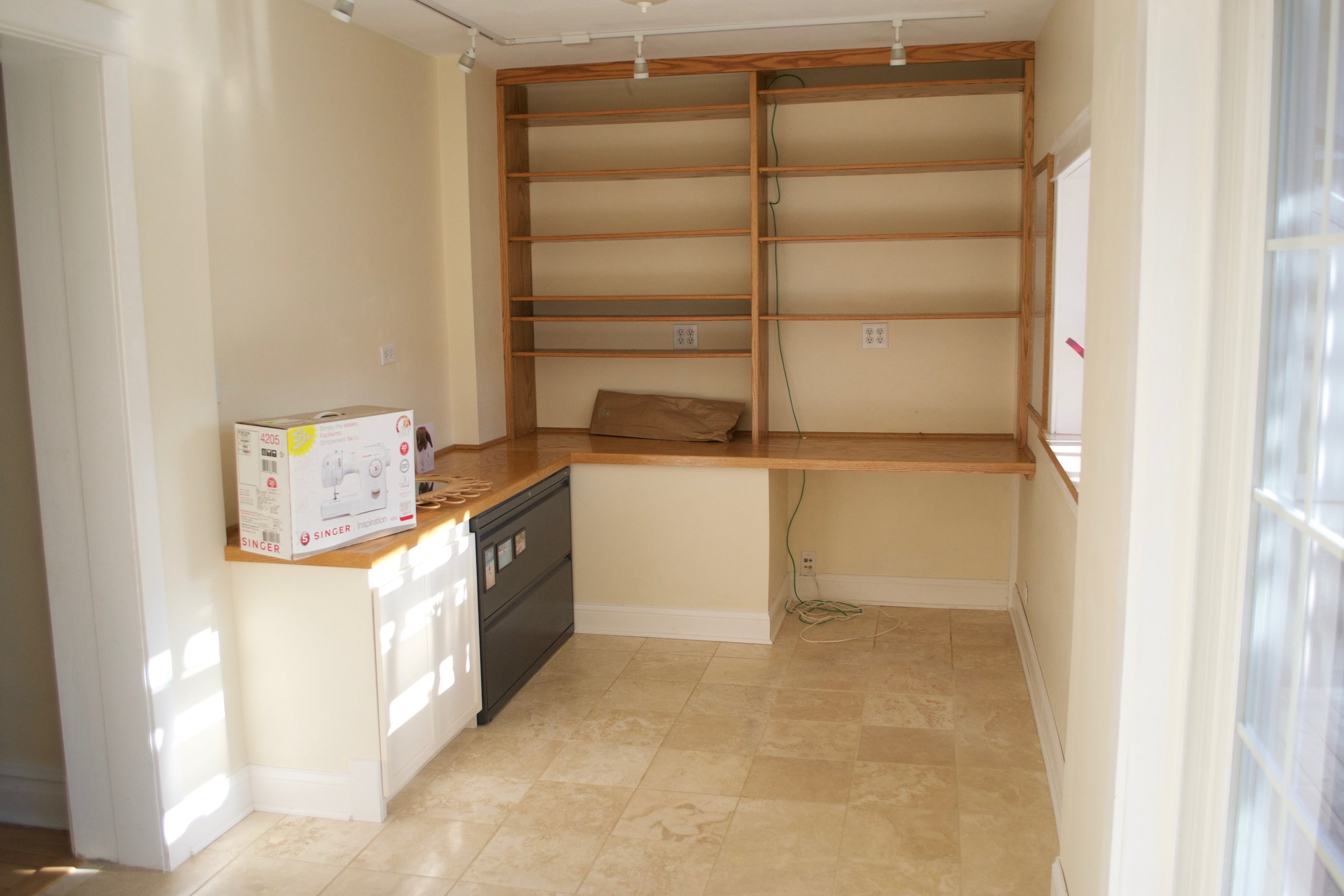 The built-in desk and shelves of our back room office