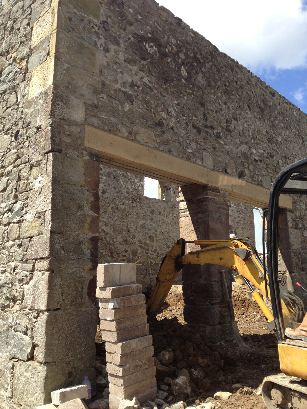 Replacement oak lintel being installed