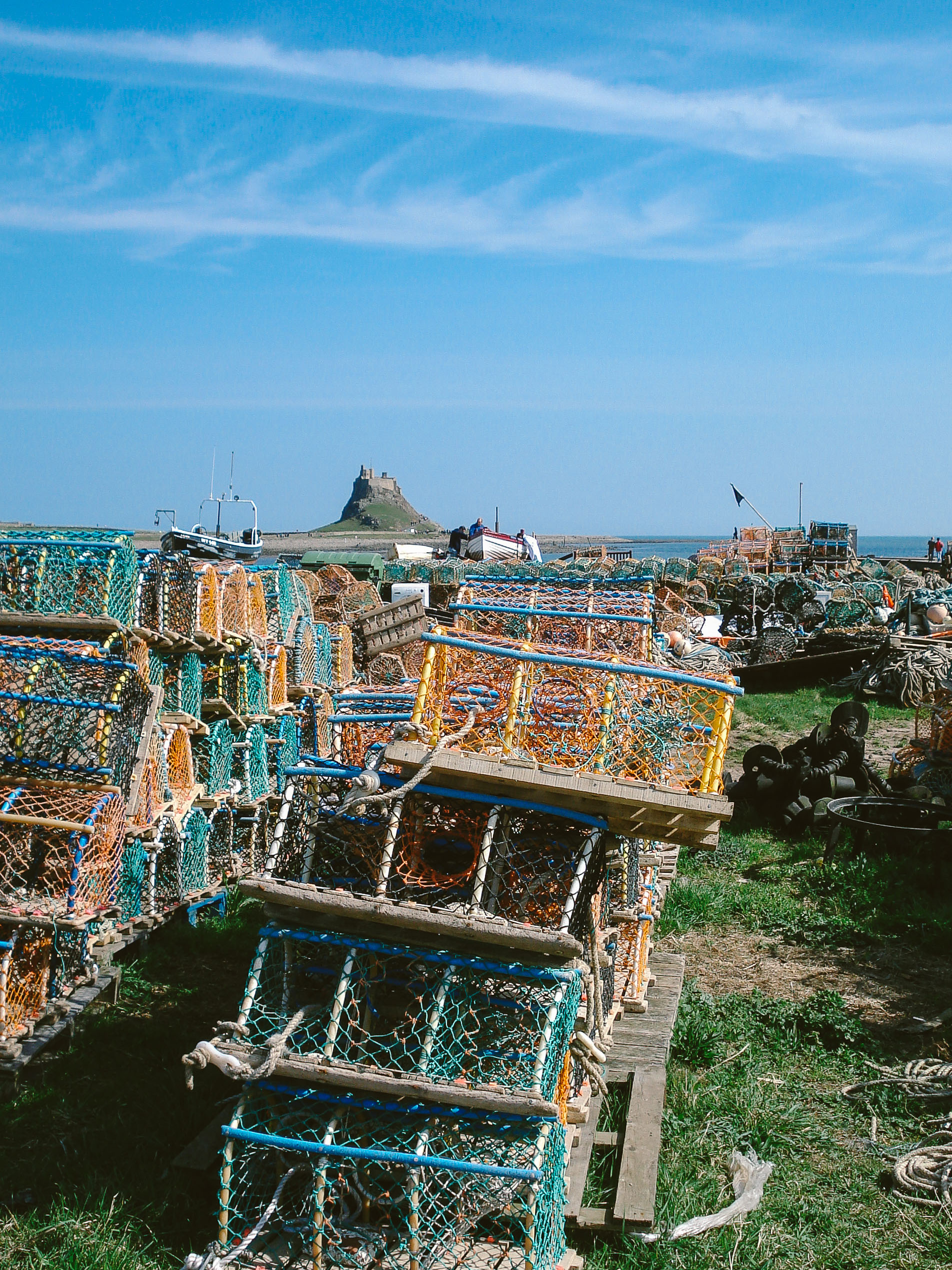 Lindisfarne Castle with Lobster Pots in the foreground