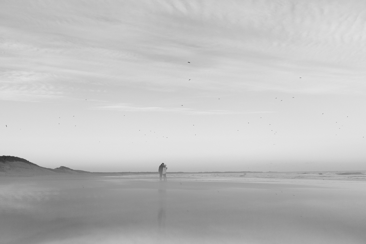 Northumberland Engagement Photographer // Nadia & Andrew // Walking on the Beach in Black and White