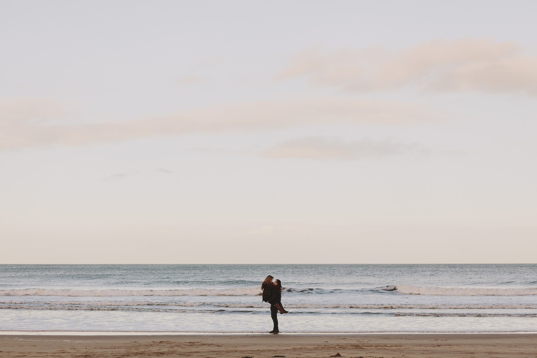Callum holding Dannielle on Bamburgh Beach, Northumberland Coast