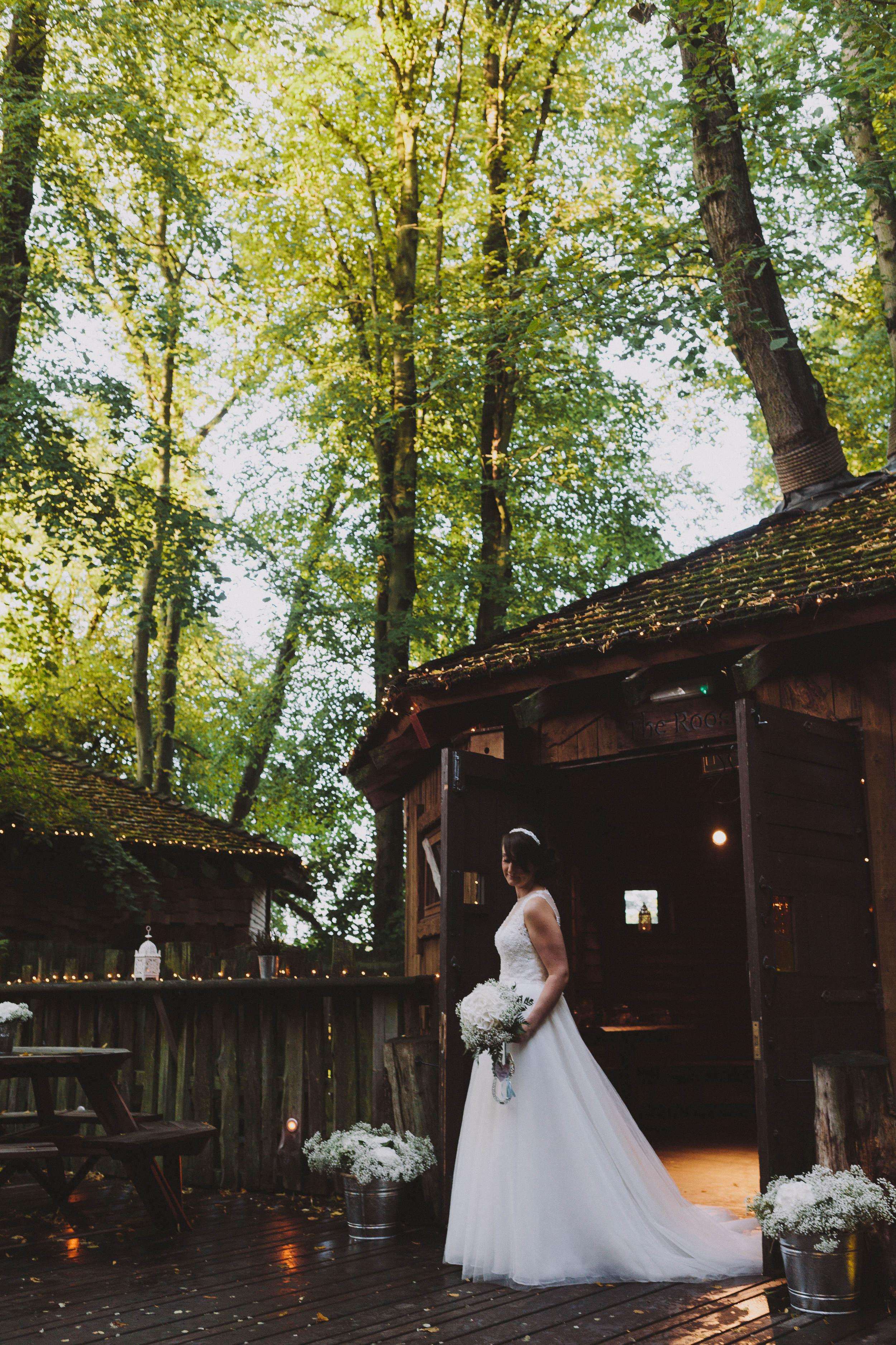 Alnwick Garden Treehouse Bride outside The Nest