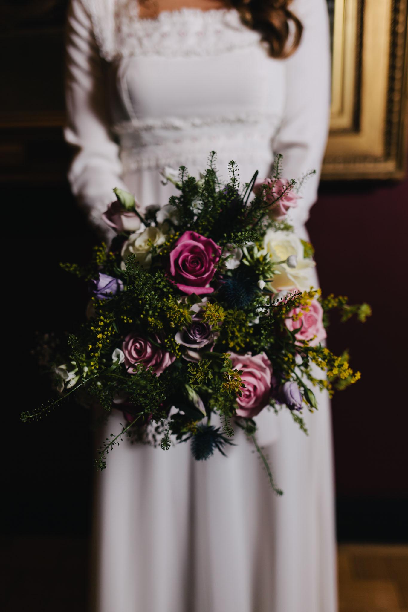Newcastle Wedding Photographer Laing Art Gallery Bride holding loose, wildflower bouquet