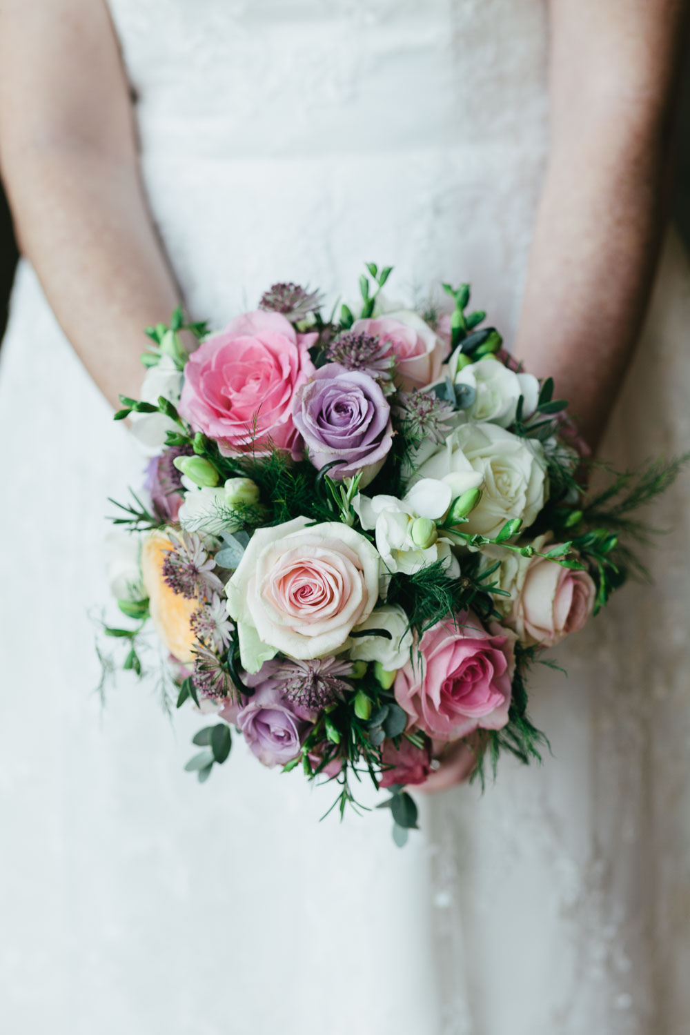 Newcastle Wedding Photographer Great North Museum Bride holding pastel roses
