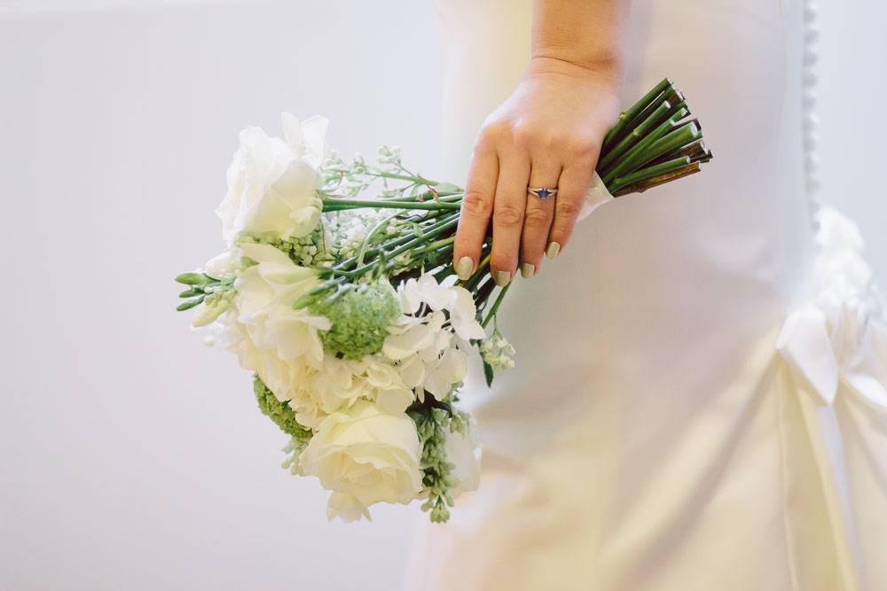 Northumberland Wedding Photographer Linden Hall Bride holding white bouquet to the side