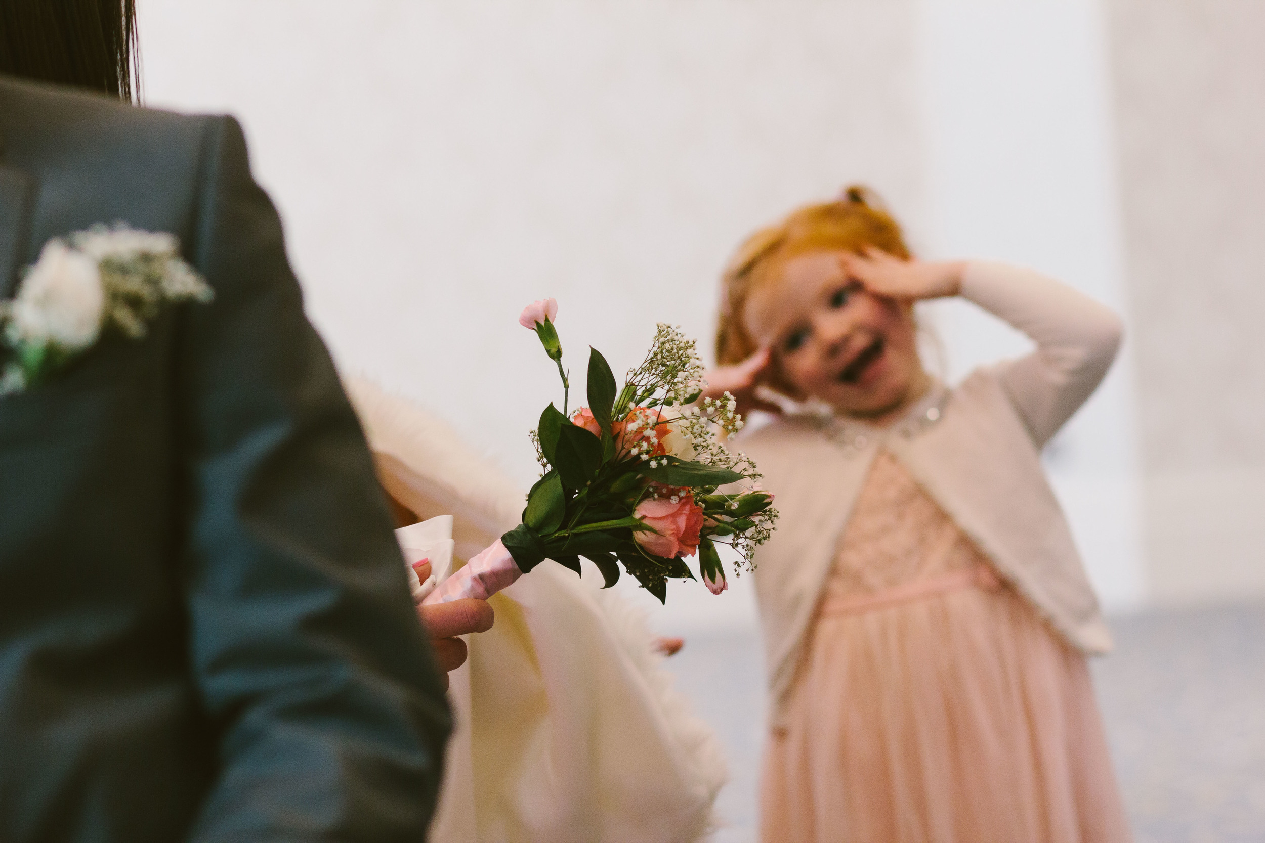 Newcastle Wedding Photographer Caledonian Hotel Bride's flowers with girl pulling a funny face