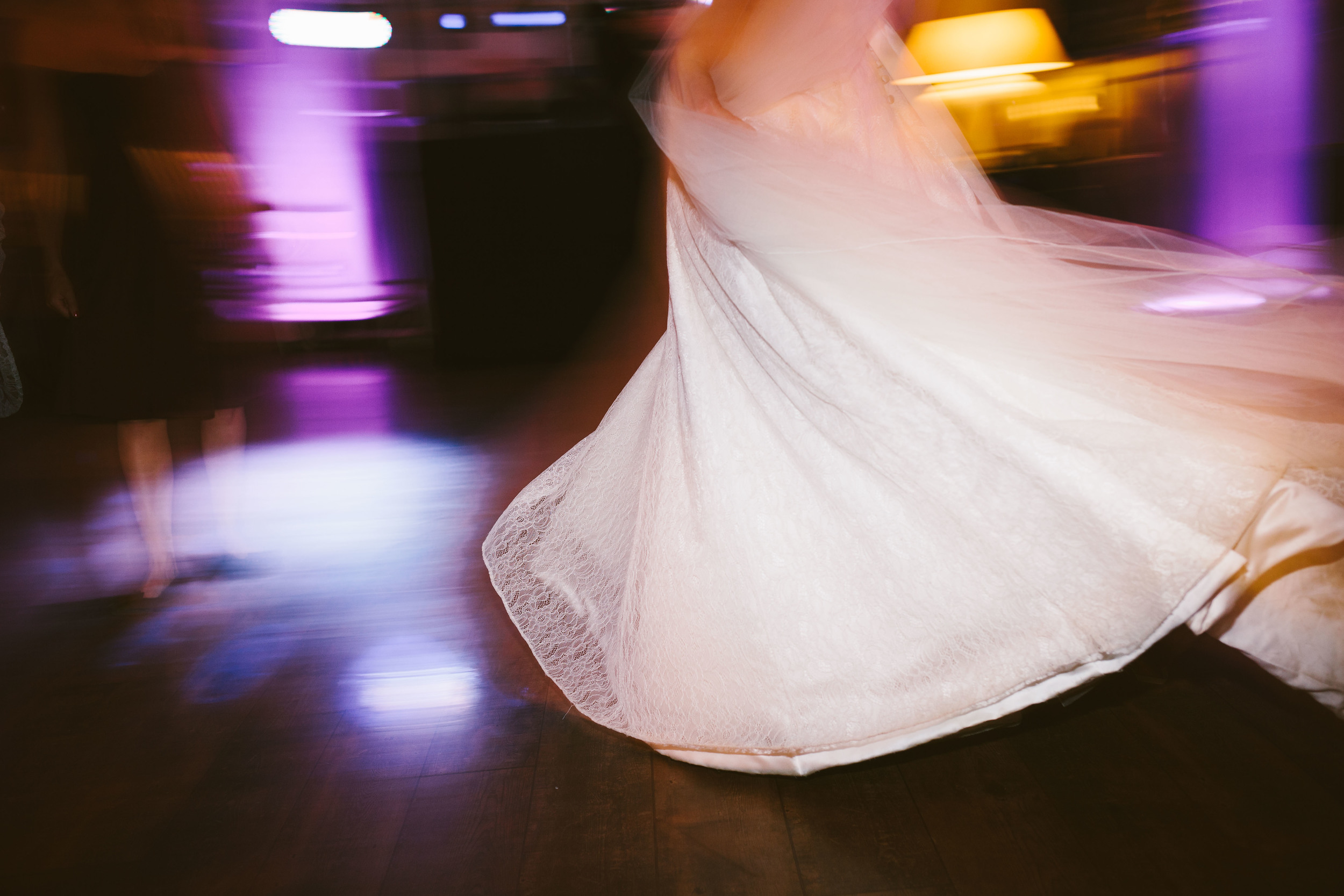 Northumberland Wedding Photographer // Close up of bride's dress on dancefloor