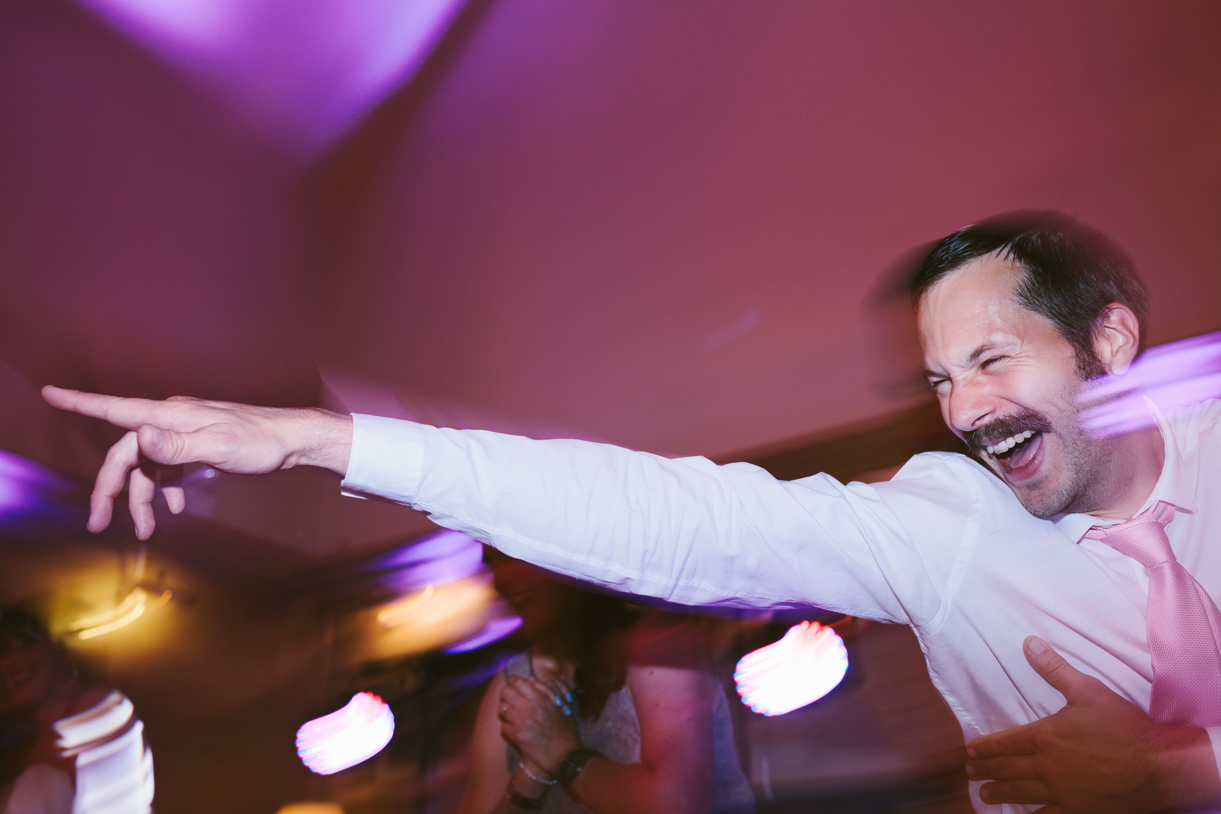 Northumberland Wedding Photographer Groomsman dancing