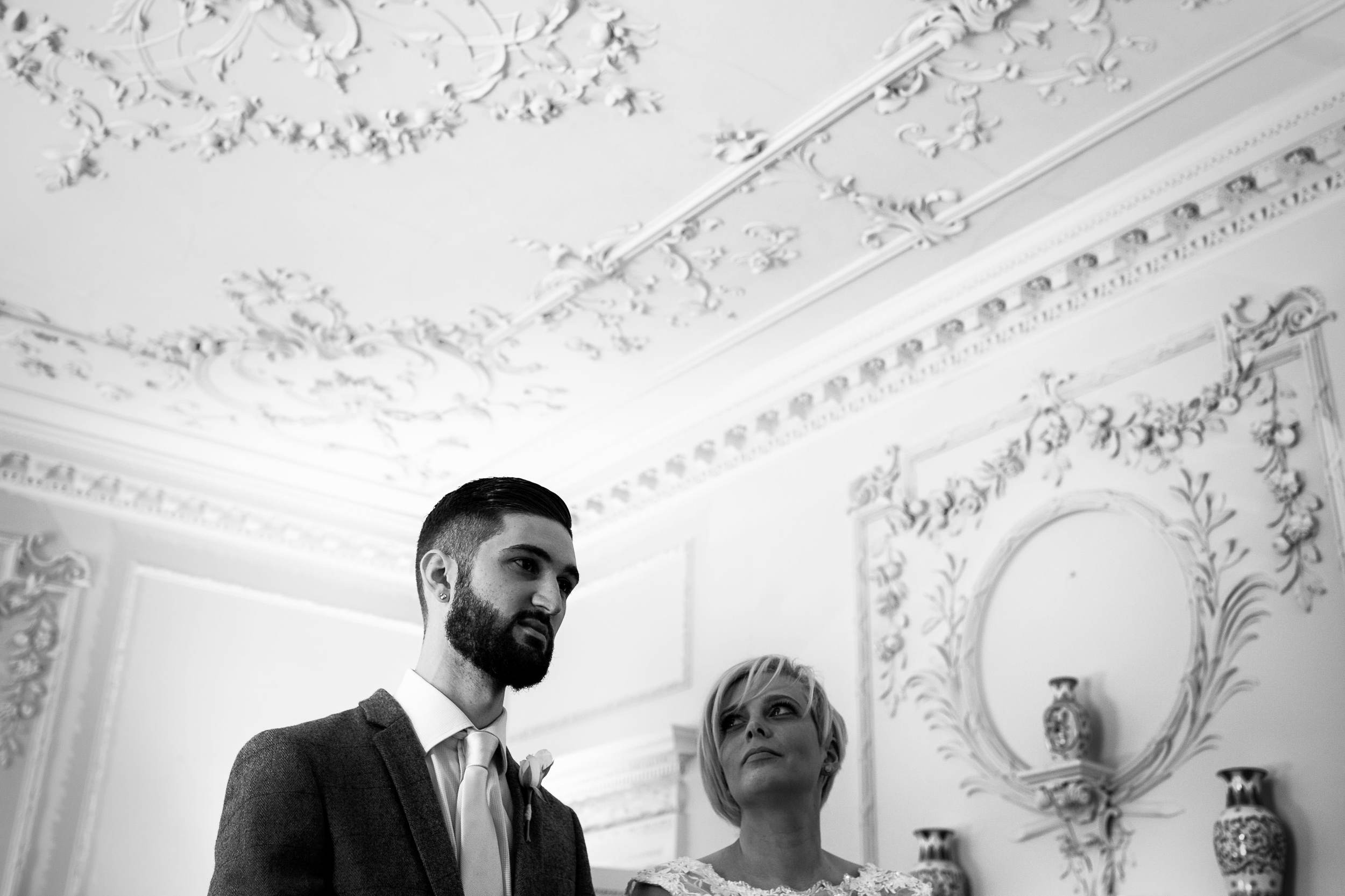 A black and white photograph of the bride looking at the groom in Durham Register Office