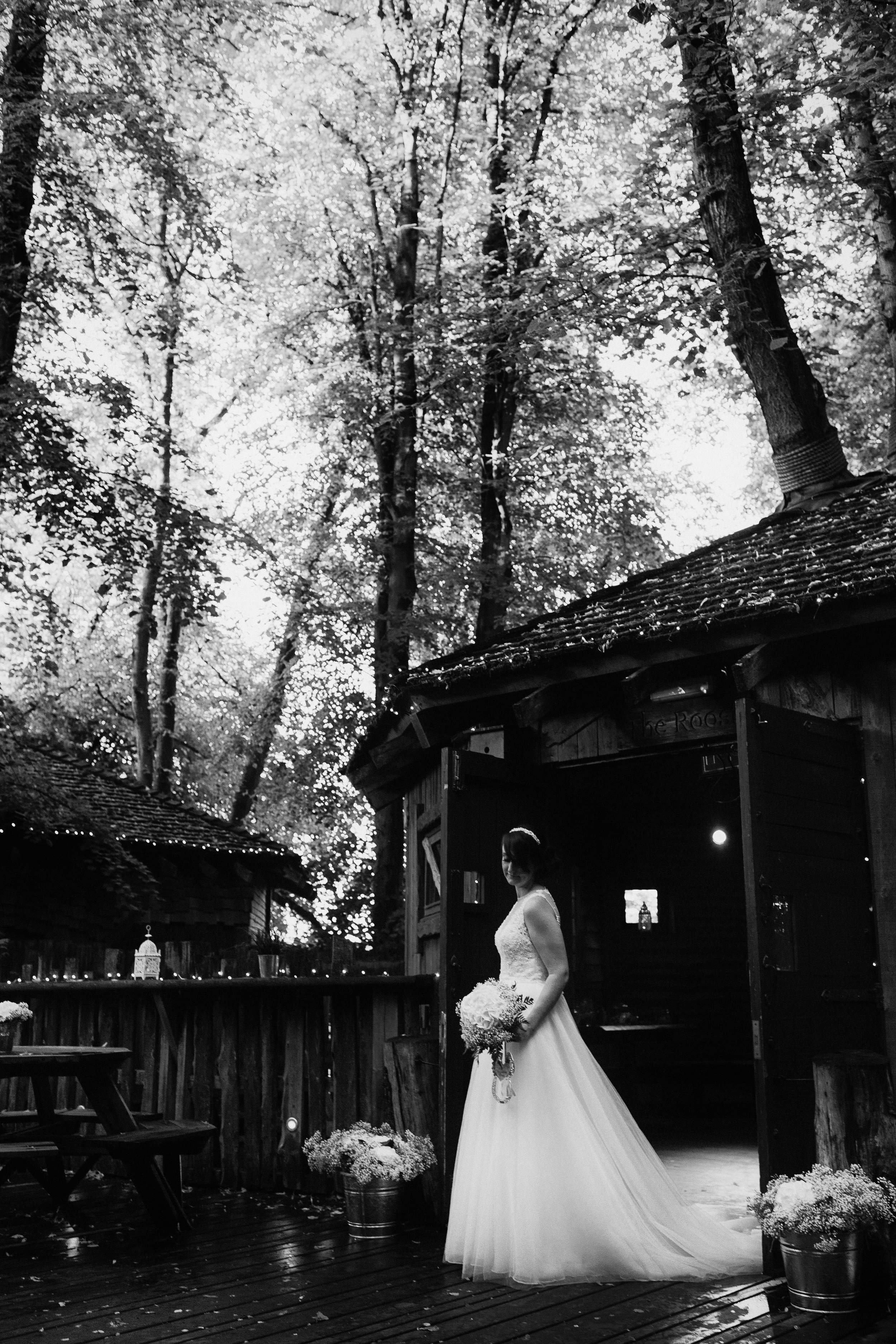 An elegant black and white portrait of the bride at Alnwick Gardens Treehouse, Northumberland