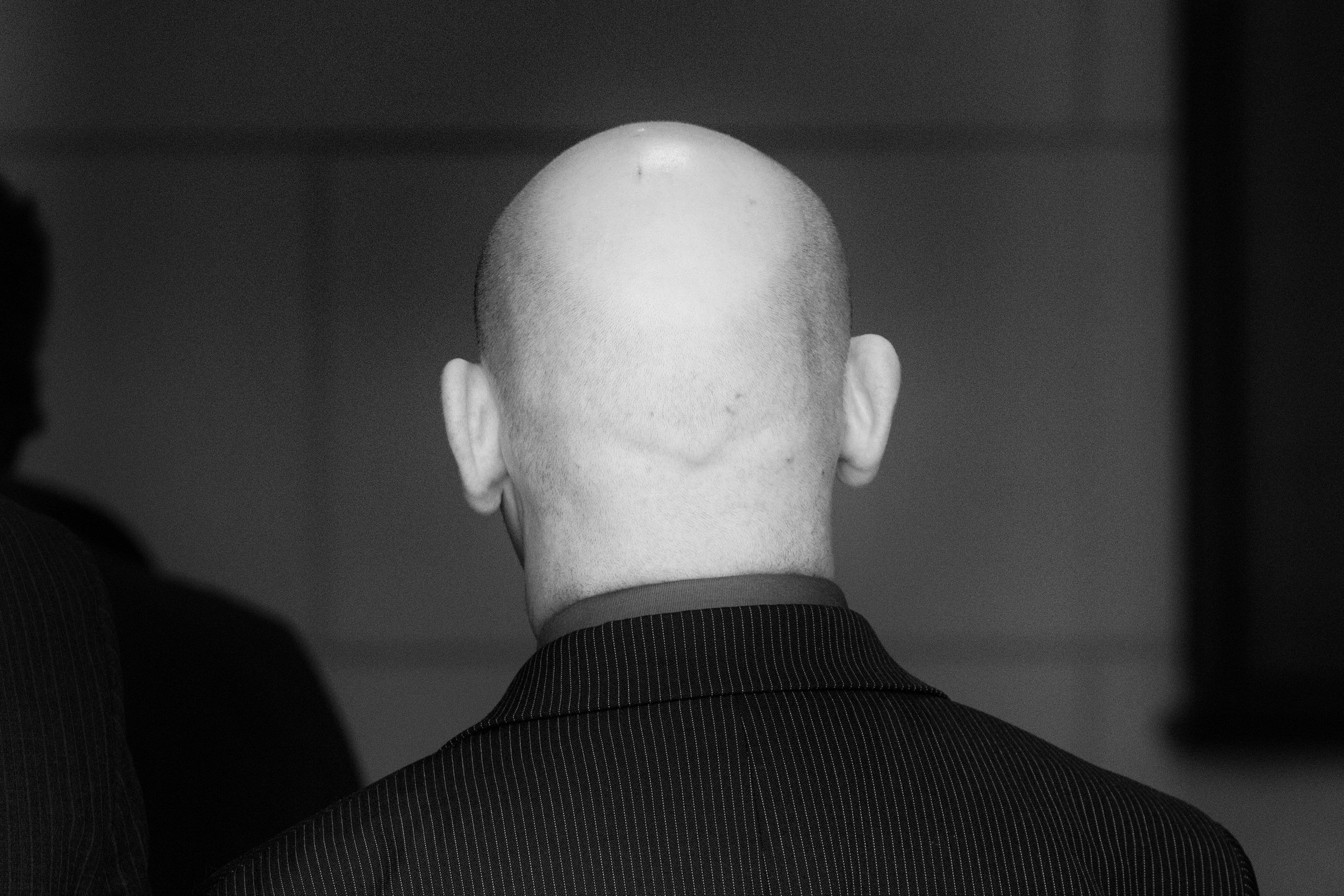 Black and White wedding portrait of the back of a guest's head