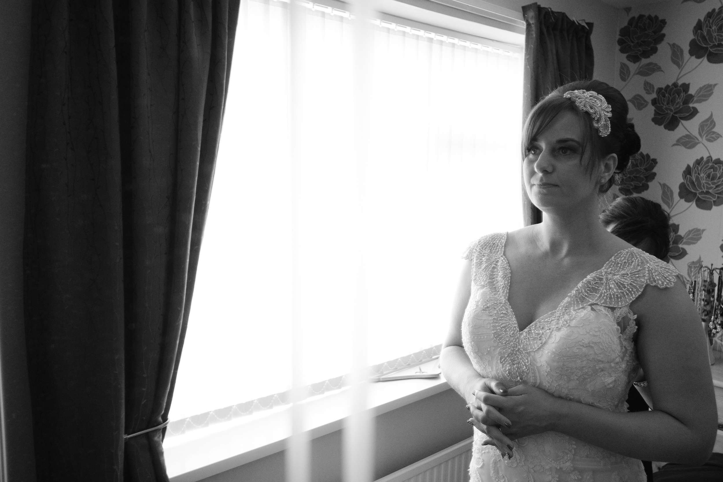 Newcastle Wedding Photographer // Bride getting into her wedding dress