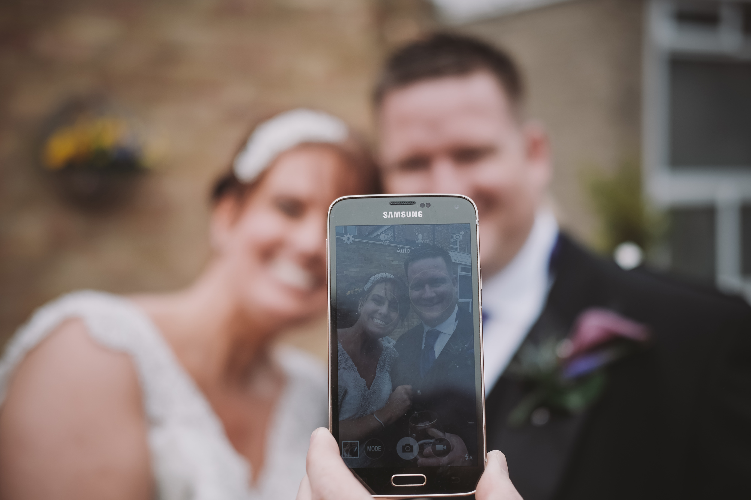 Newcastle Wedding Photographer // Bride and groom taking a selfie