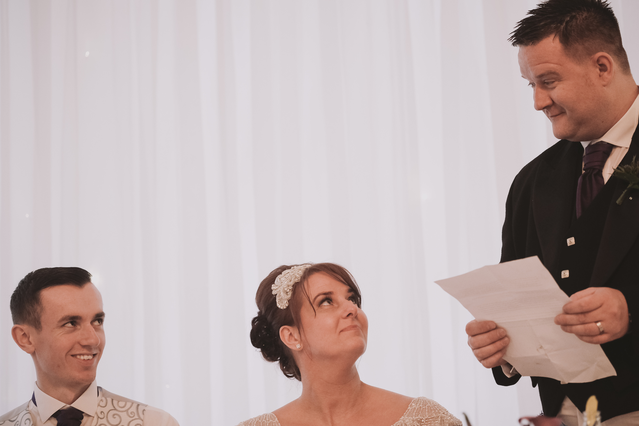 Newcastle Wedding Photographer // Groom eye contact with bride's son during speech