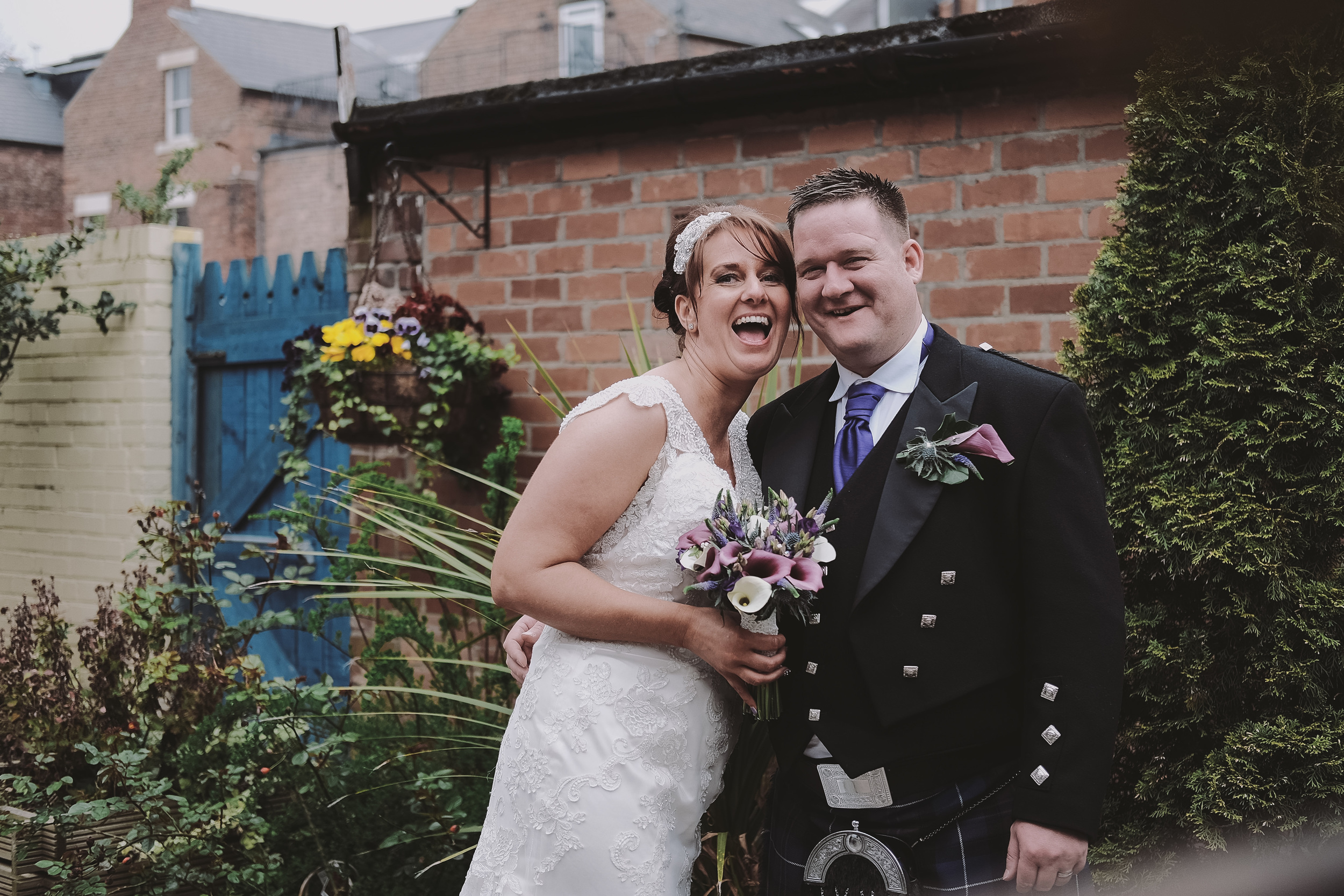 Newcastle Wedding Photographer // Bride and groom posing in secret garden of Caledonian Hotel