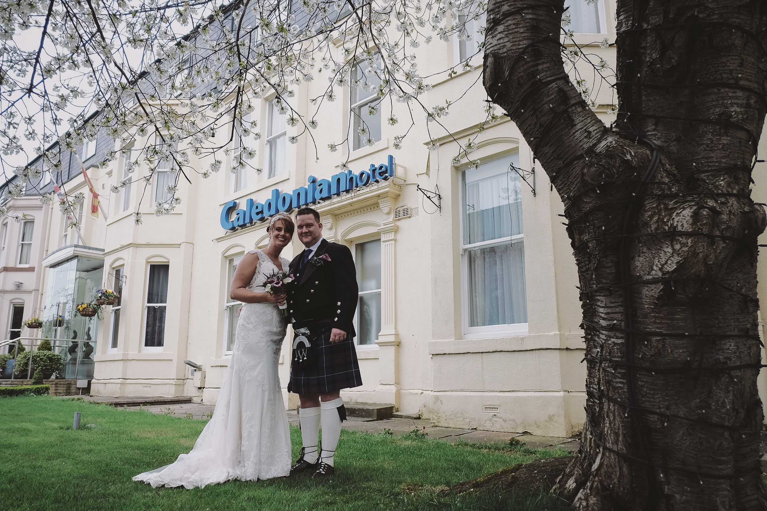 Newcastle Wedding Photographer // Bride and groom pose outside Caledonian Hotel