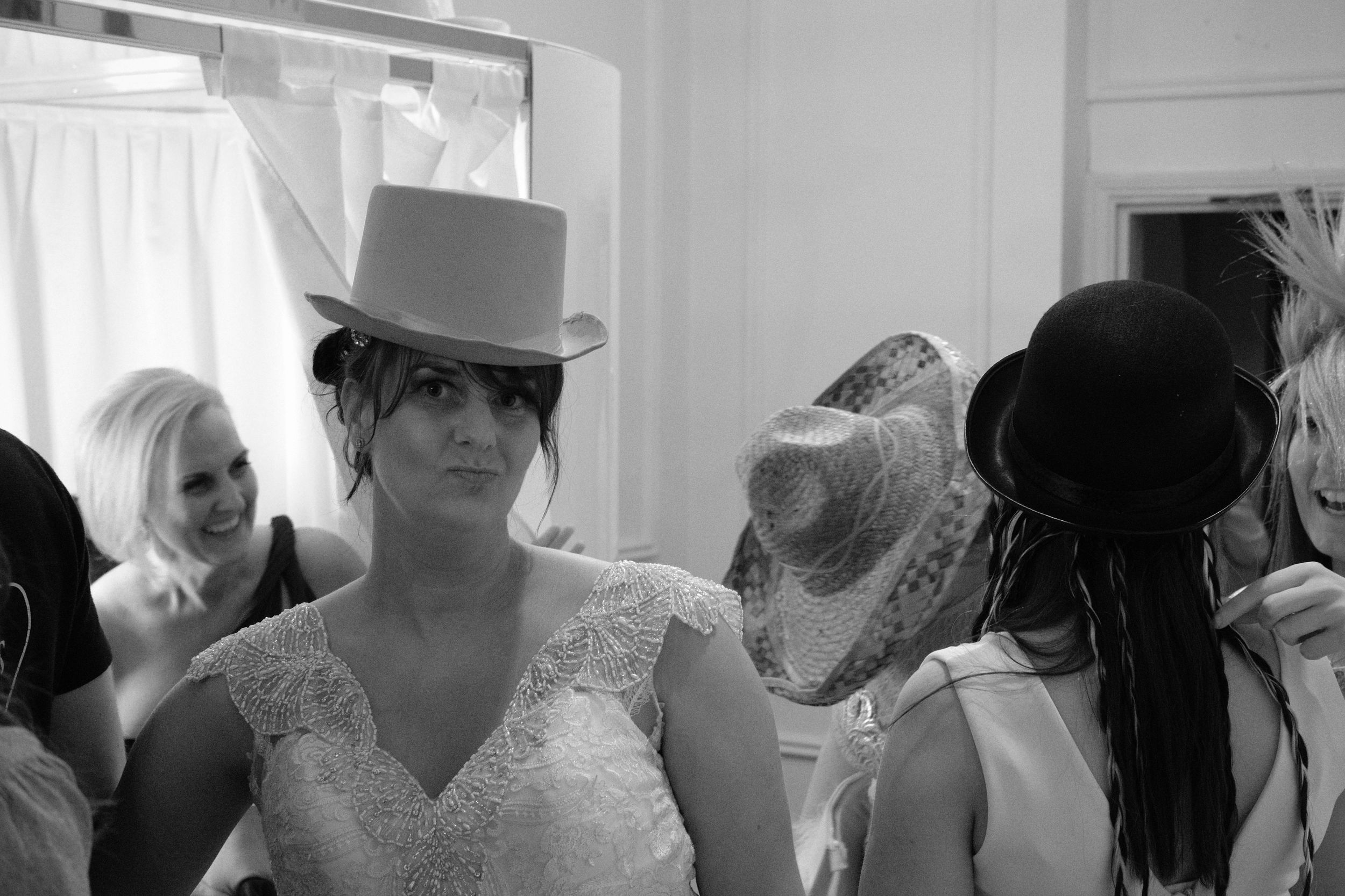 Newcastle Wedding Photographer // Bride tries on guest's hat at reception