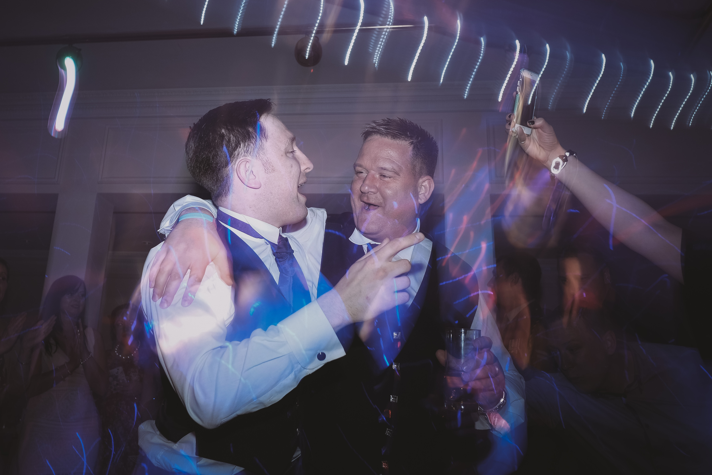 Newcastle Wedding Photographer // Groom dances with best man on dance floor
