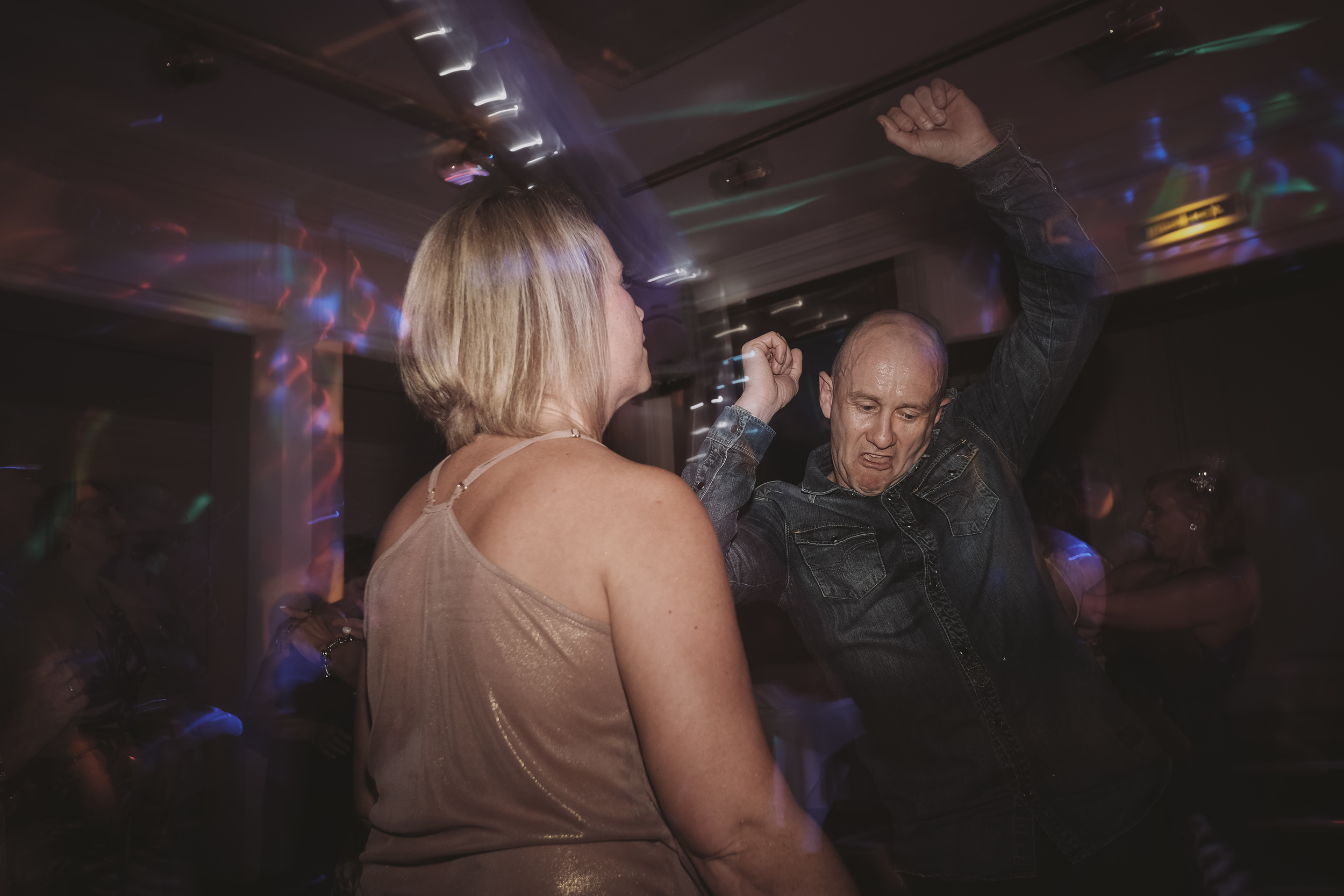 Newcastle Wedding Photographer // Couple busting out moves on wedding dancefloor
