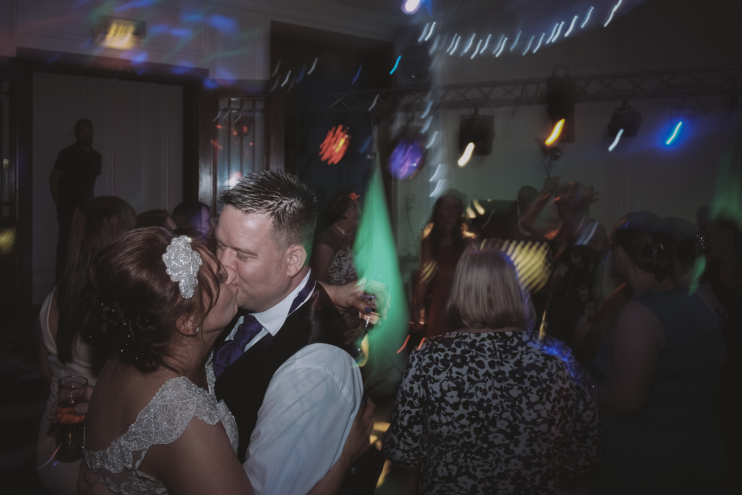 Newcastle Wedding Photographer // Bride and groom kiss on dancefloor at end of wedding