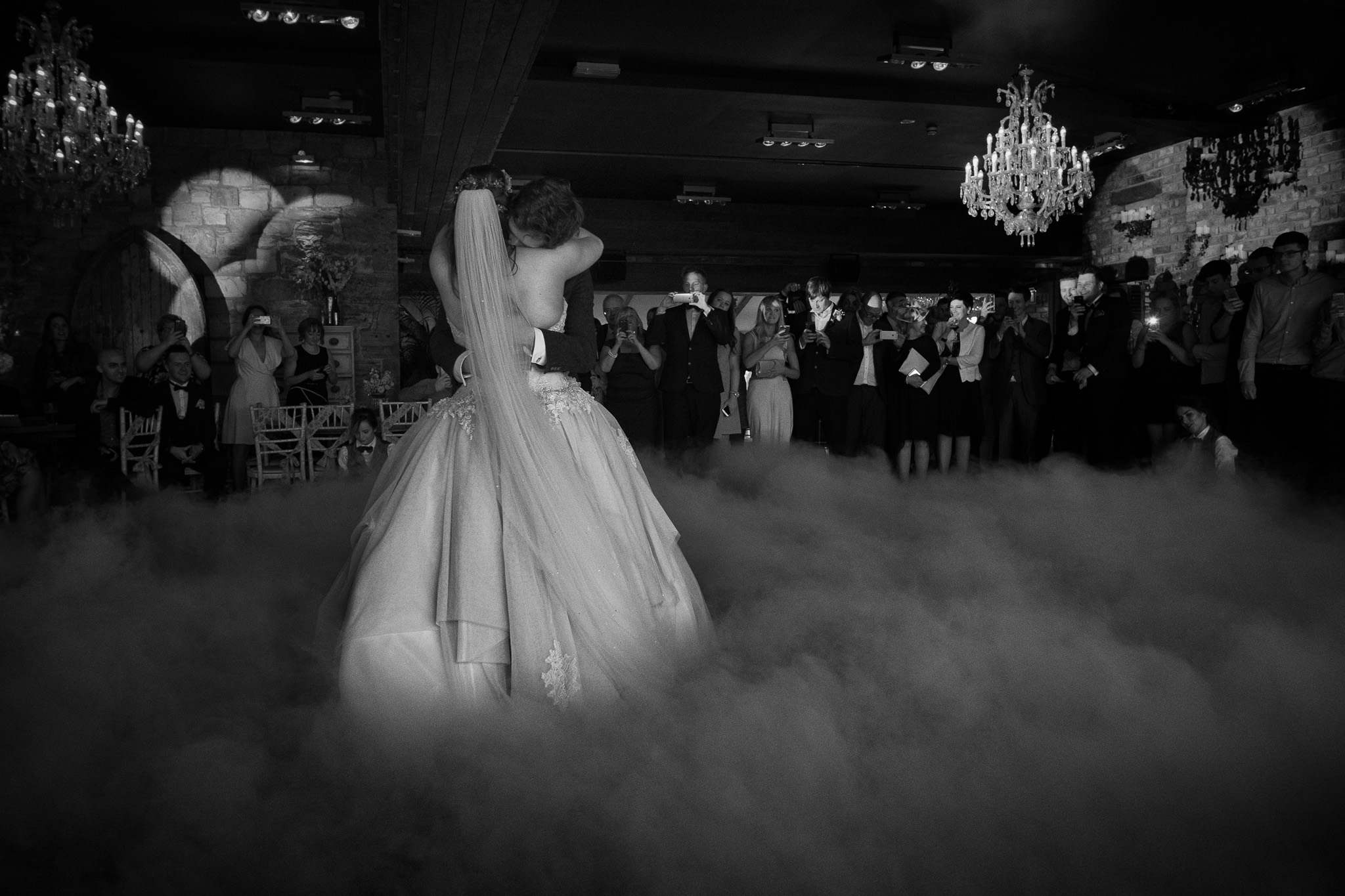 A black and white photo of Tanya and Craig's first dance at Newton Hall Northumberland by Barry Forshaw
