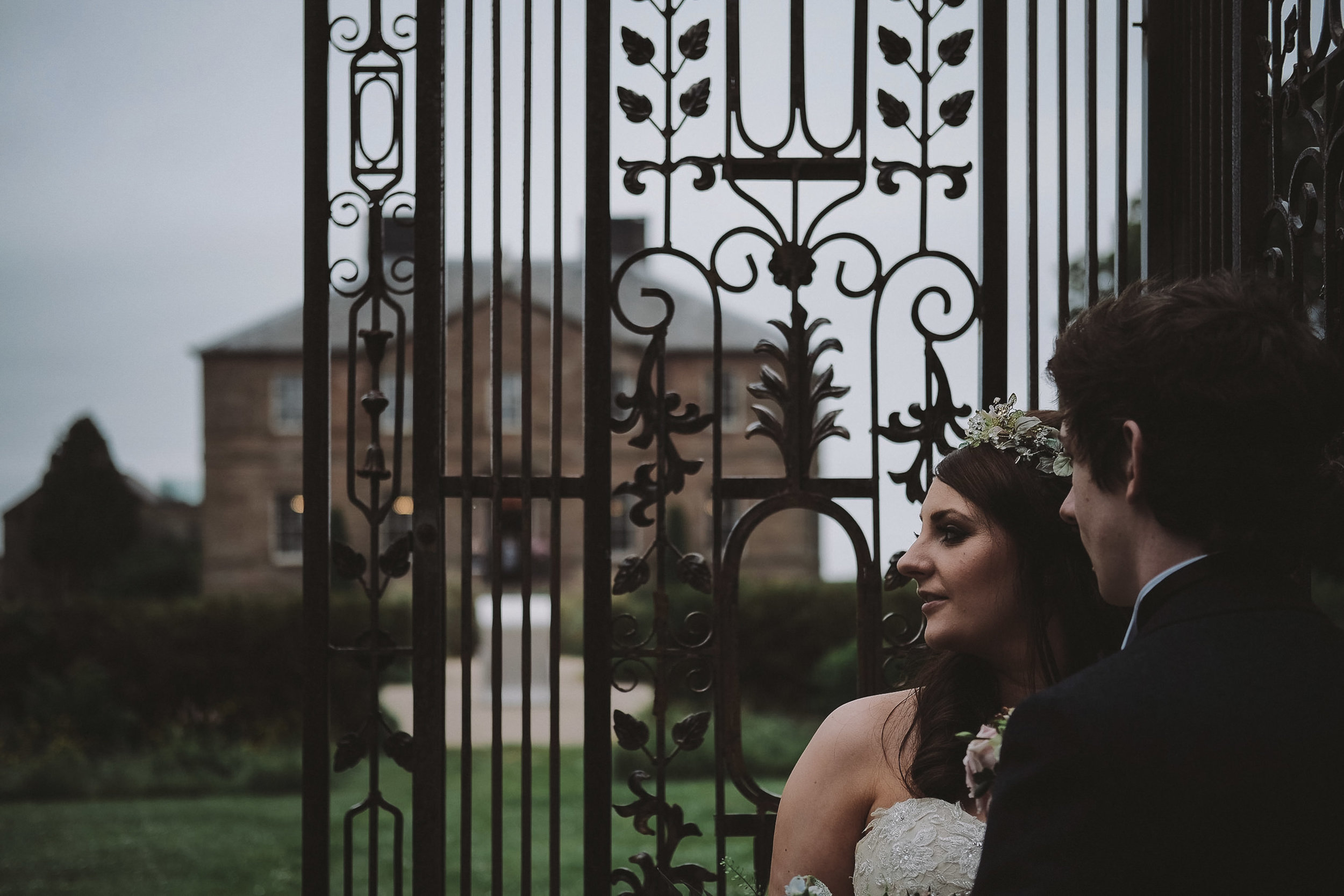Head and shoulder portrait of the bride and groom in the grounds at Newton Hall, Northumberland by Barry Forshaw