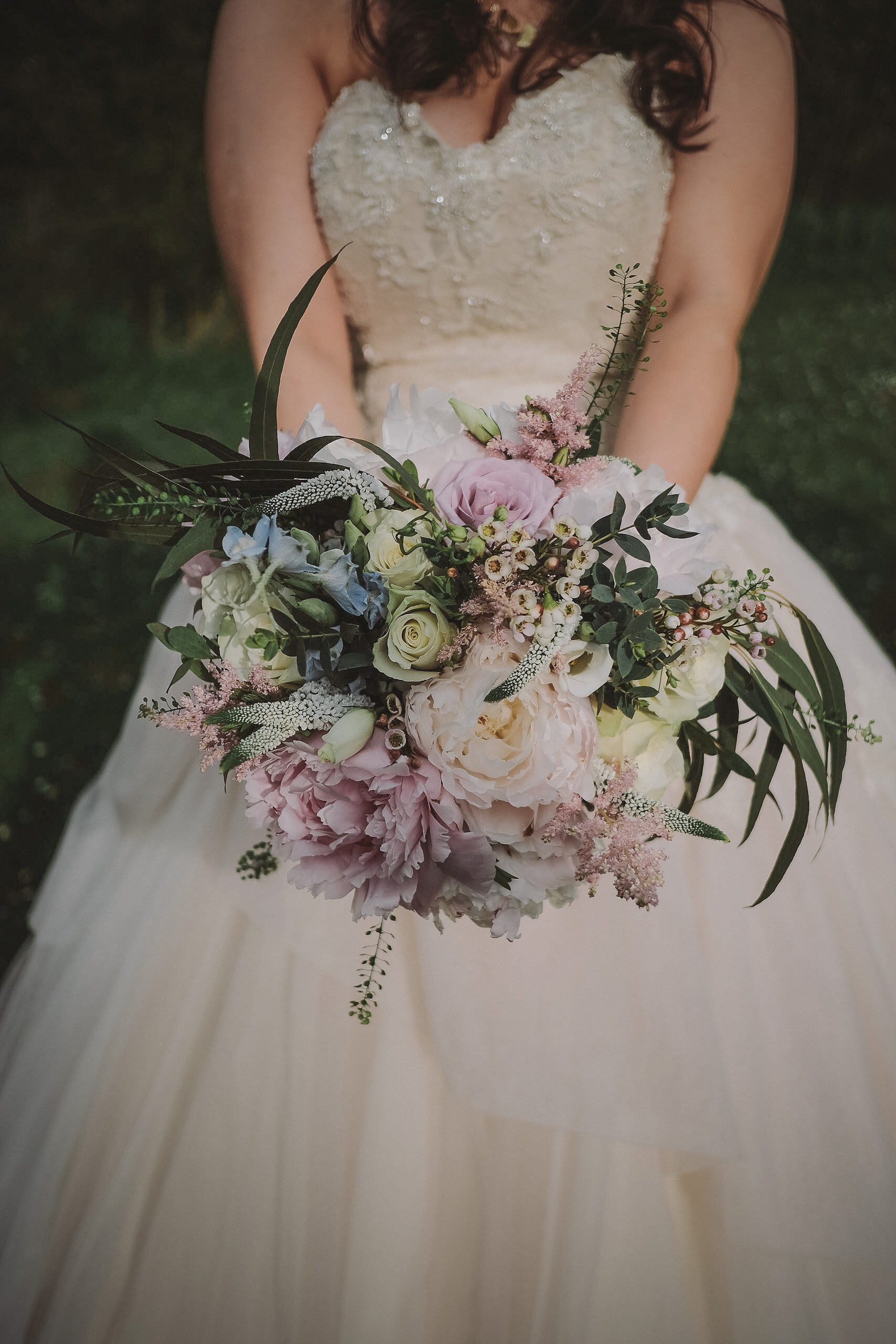 A close up of the bride holding the bridal bouquet at Newton Hall Northumberland by Barry Forshaw
