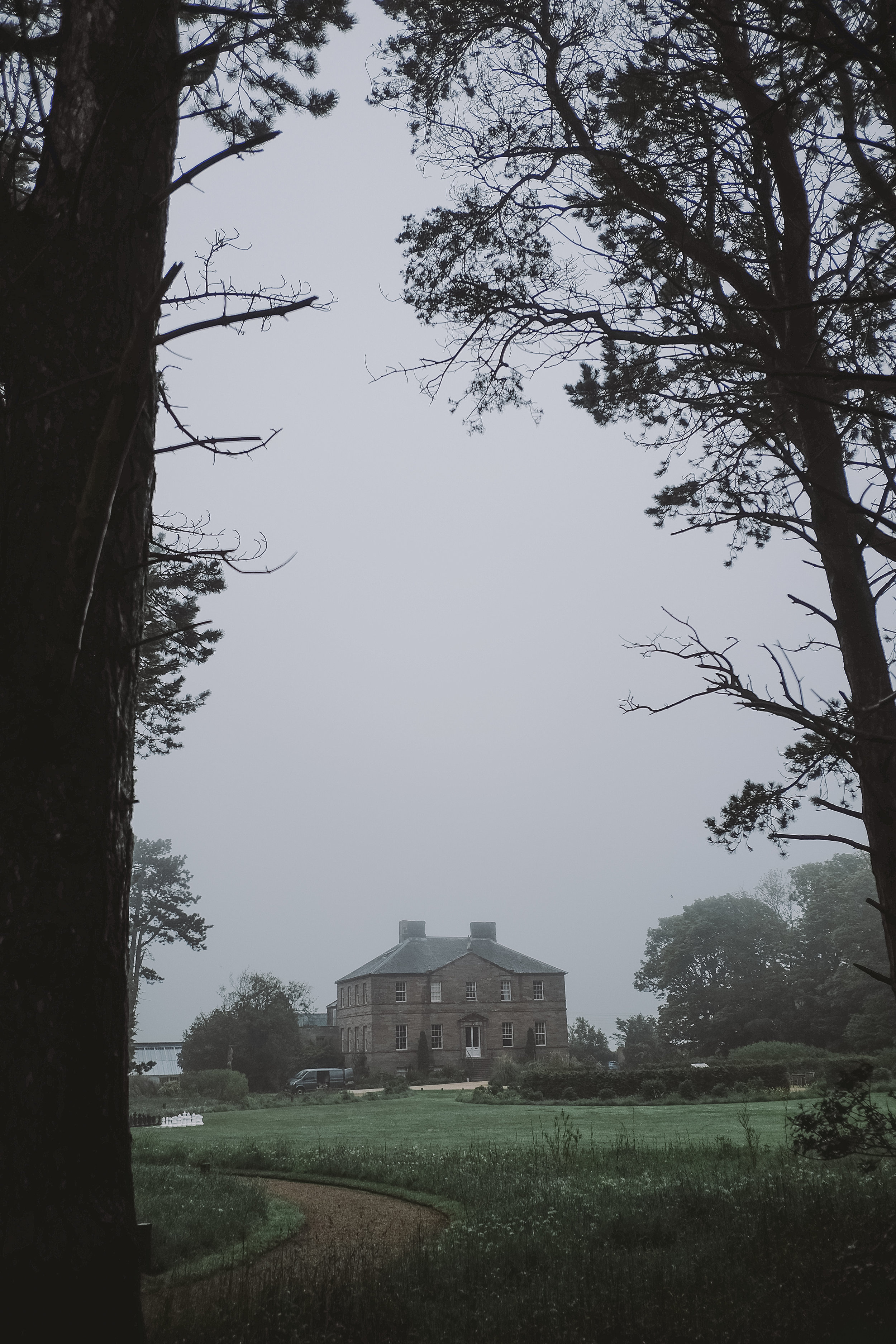 Newton Hall on the foggy morning of Tanya and Craig's wedding in Northumberland by Barry Forshaw