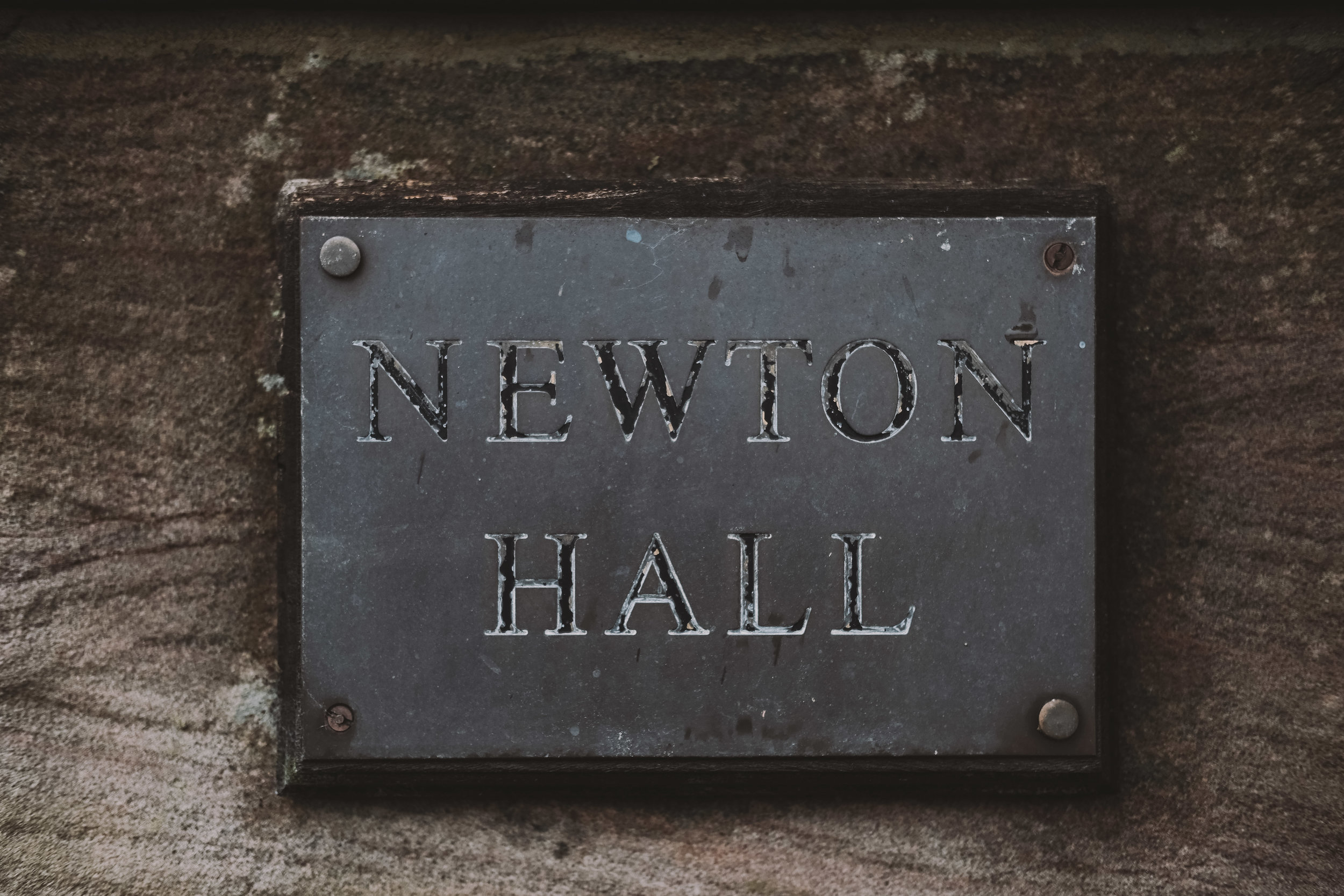 The faded sign at the entrance of Newton Hall, Northumberland by Barry Forshaw