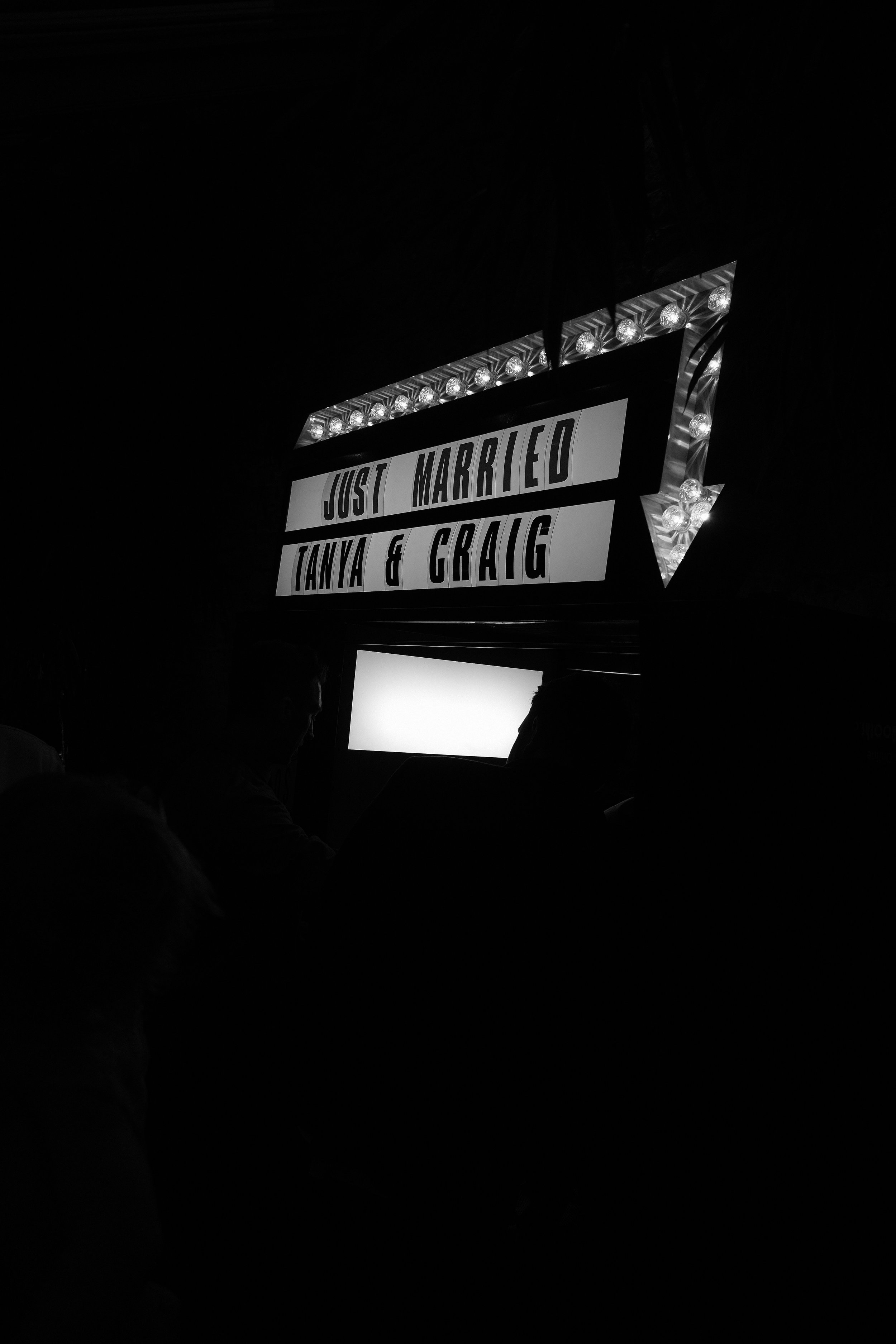 The sign outside the Photo Booth was in the style of a movie theatre at a wedding at Newton Hall Northumberland by Barry Forshaw