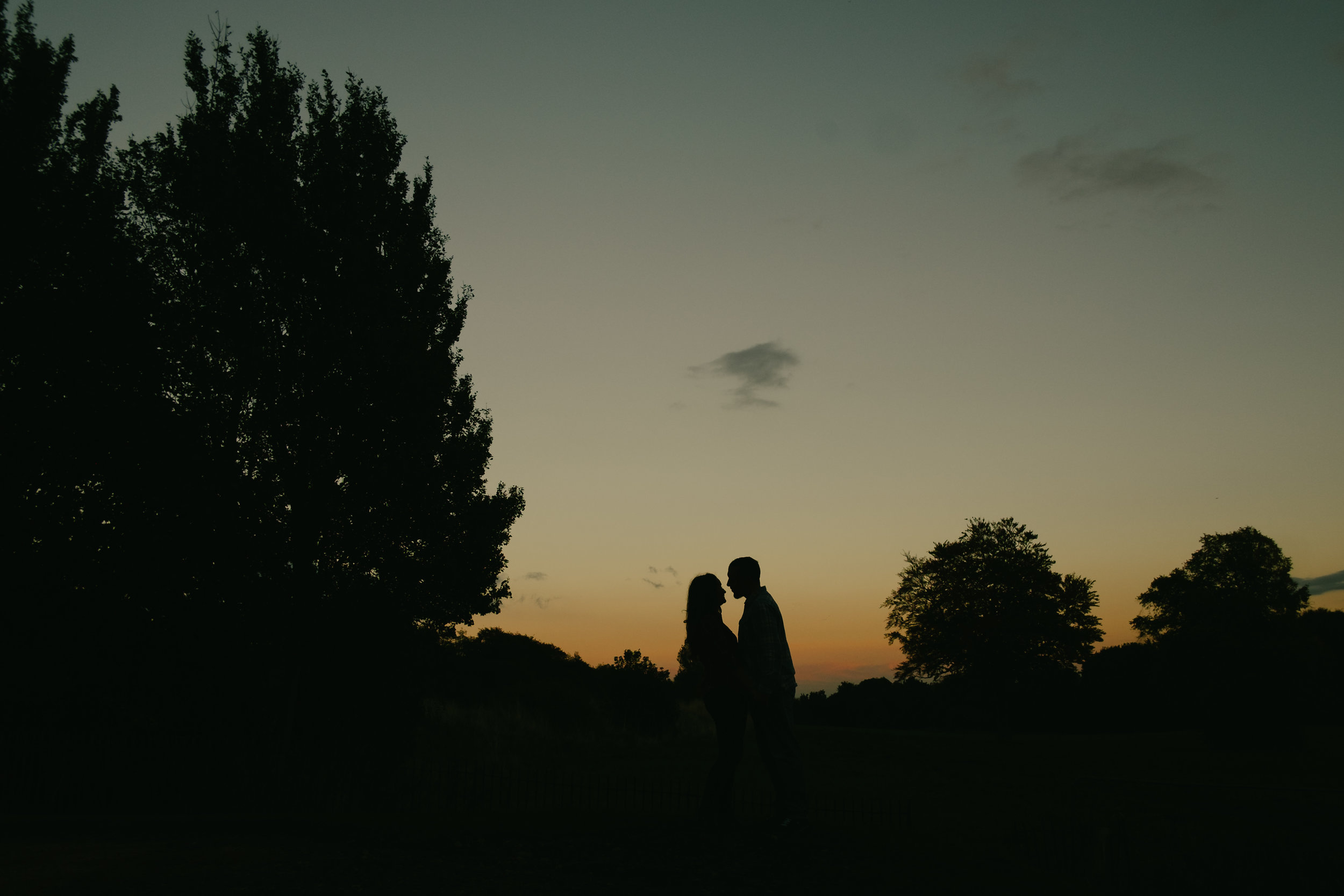 A sunset silhouette of Jen and Joe at Hylton Castle Sunderland on their pre-wedding photo shoot