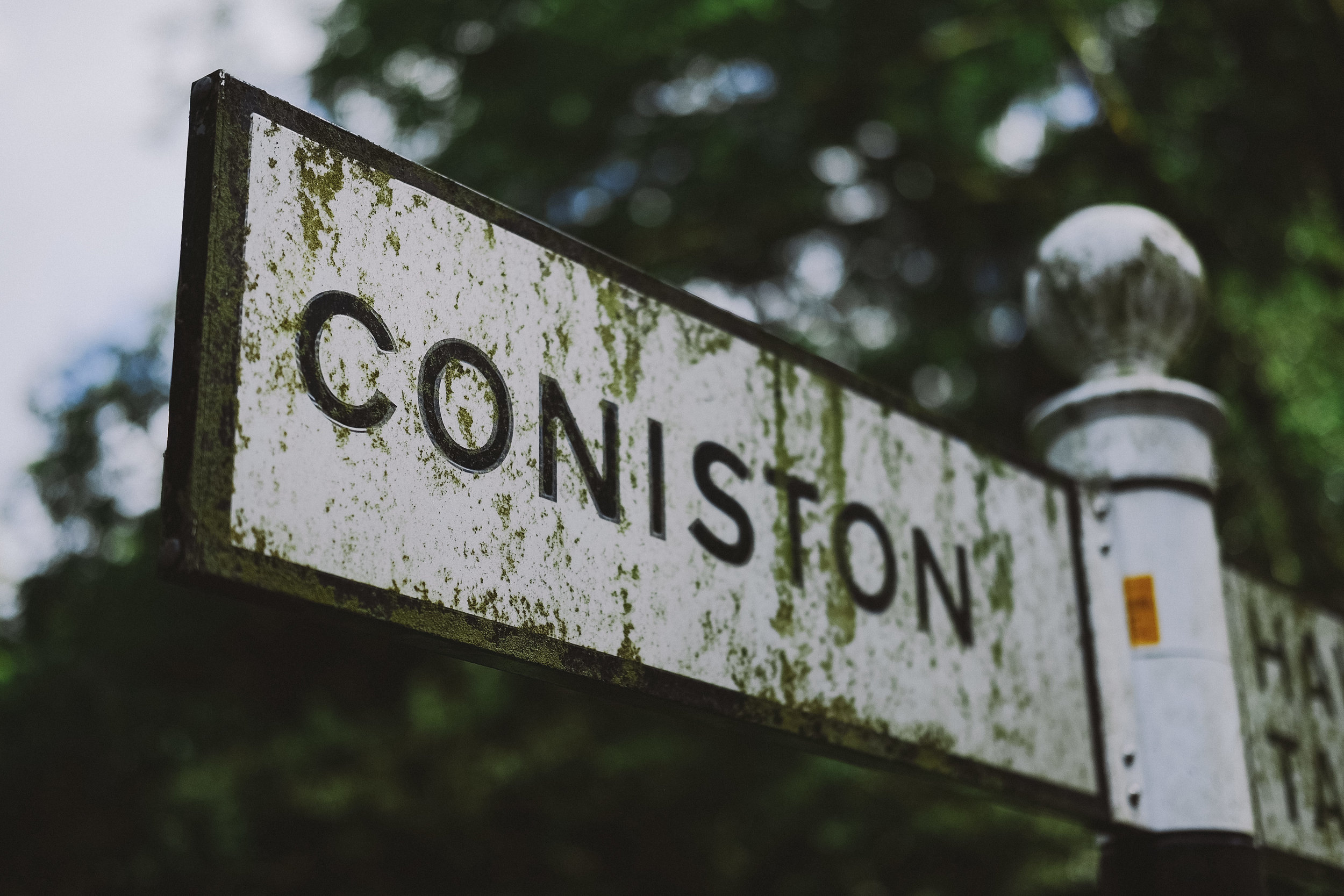 The signpost for Coniston at Julia and Darren's Lake District wedding by Barry Forshaw