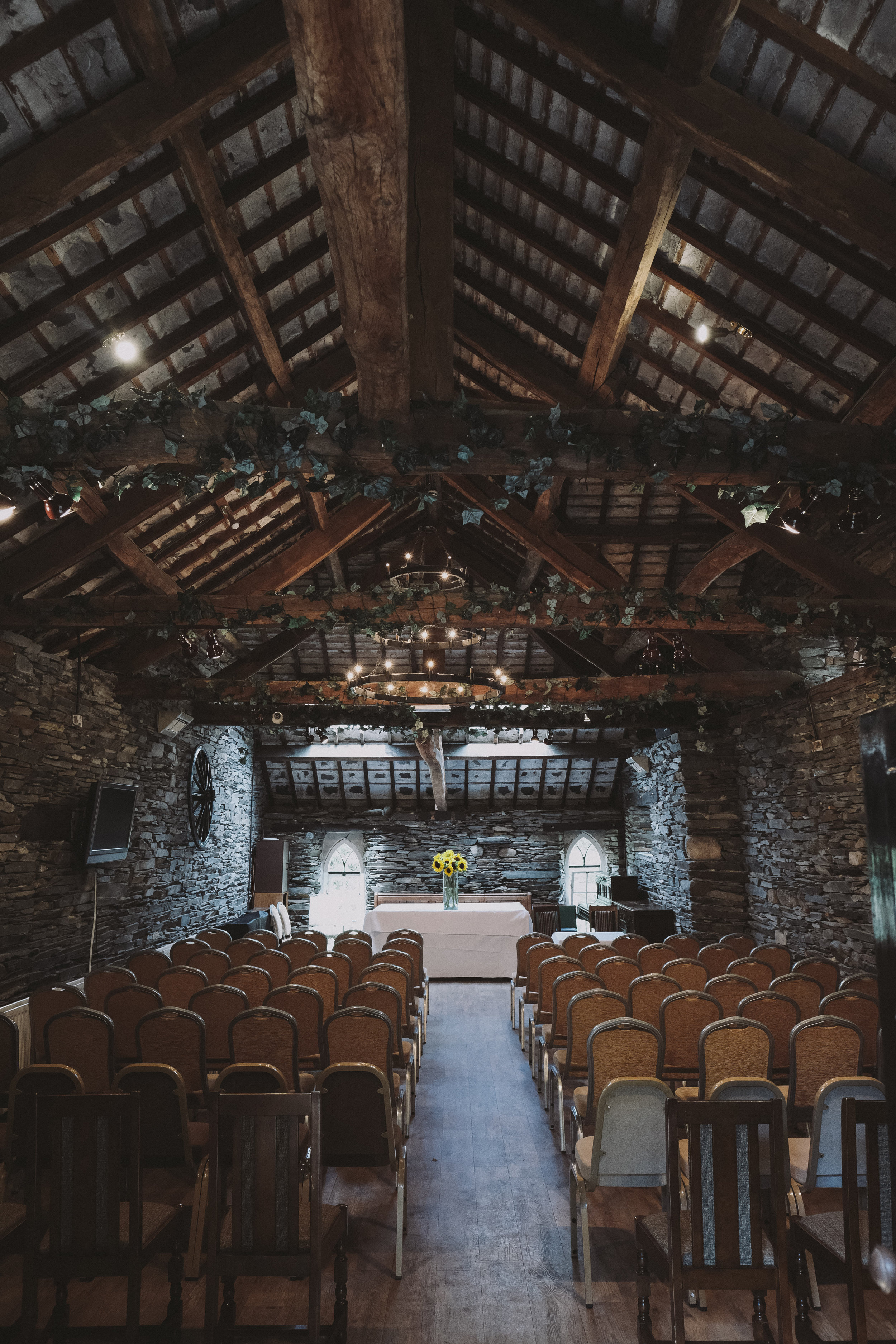 The interior of the slate barn where the ceremony was held at Julia and Darren's Lake District wedding by Barry Forshaw
