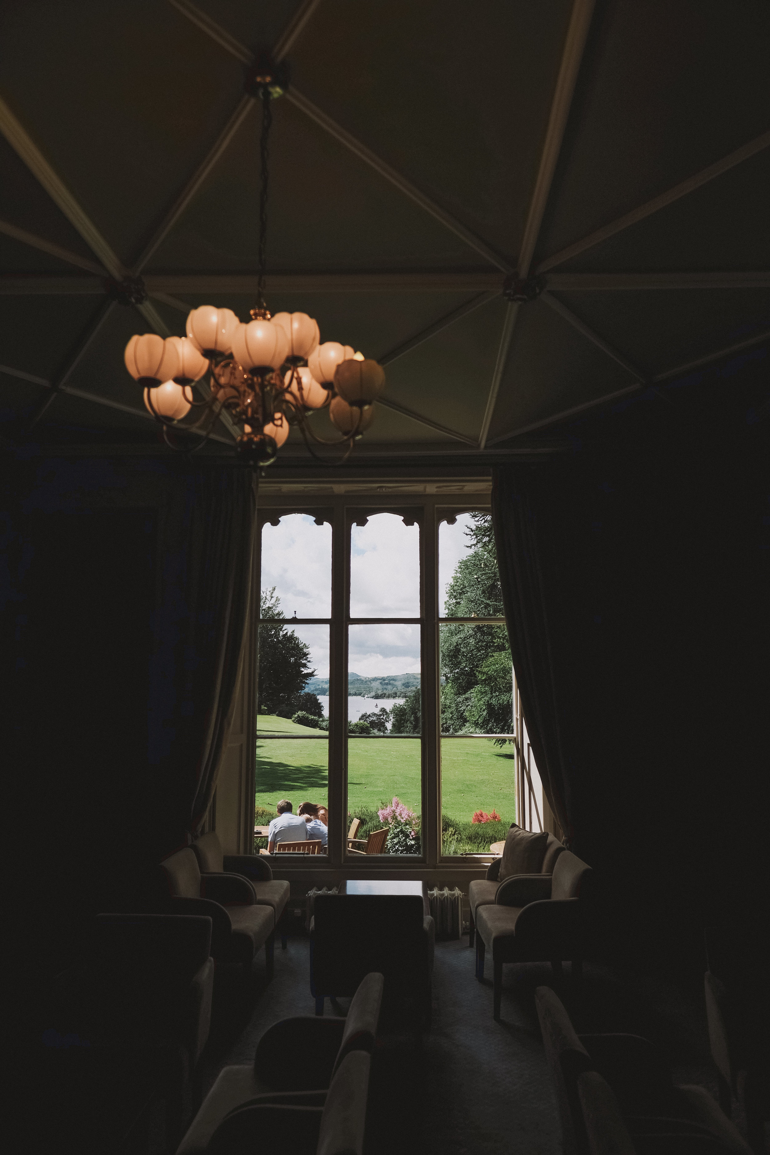 Coniston Water as seen through the window of Monk Coniston Hall at Julia and Darren's Lake District wedding by Barry Forshaw