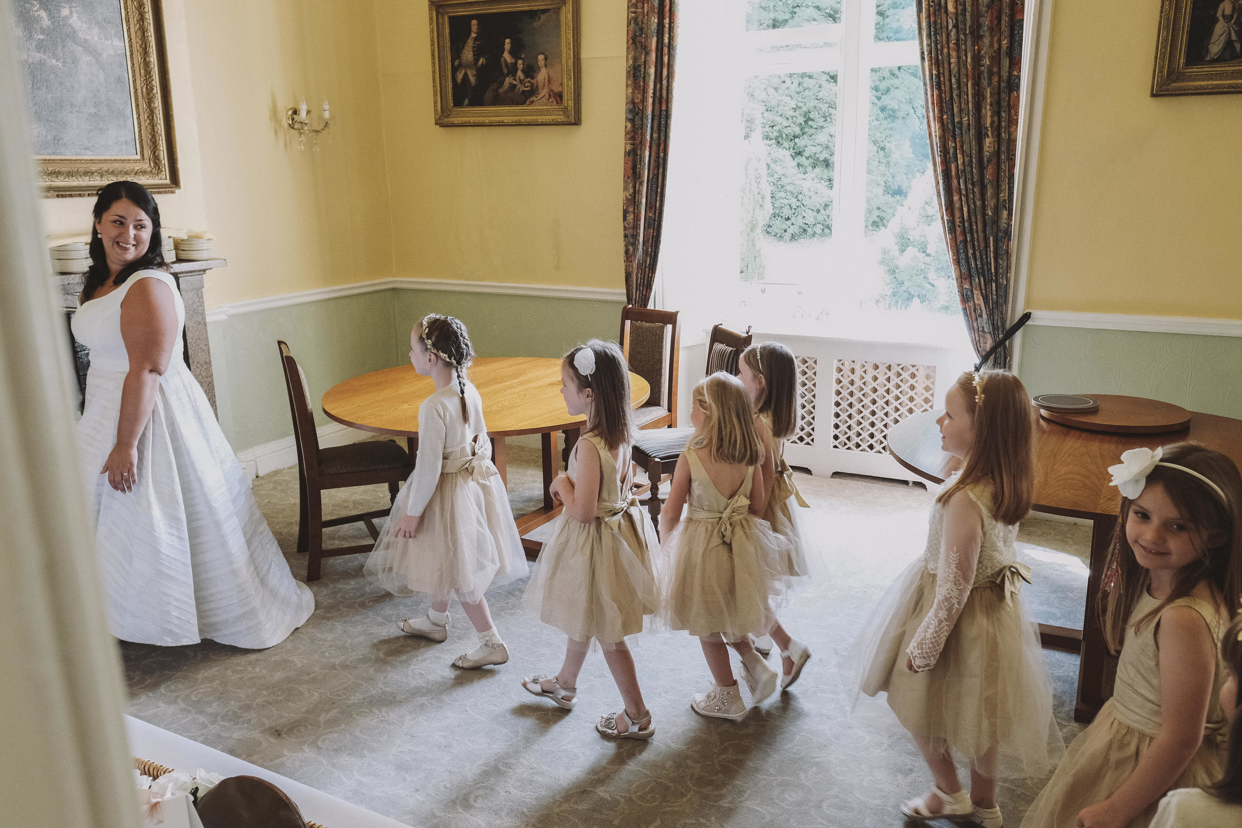 Flowergirls follow the bride as they practice their walk down the aisle at Julia and Darren's Lake District wedding by Barry Forshaw