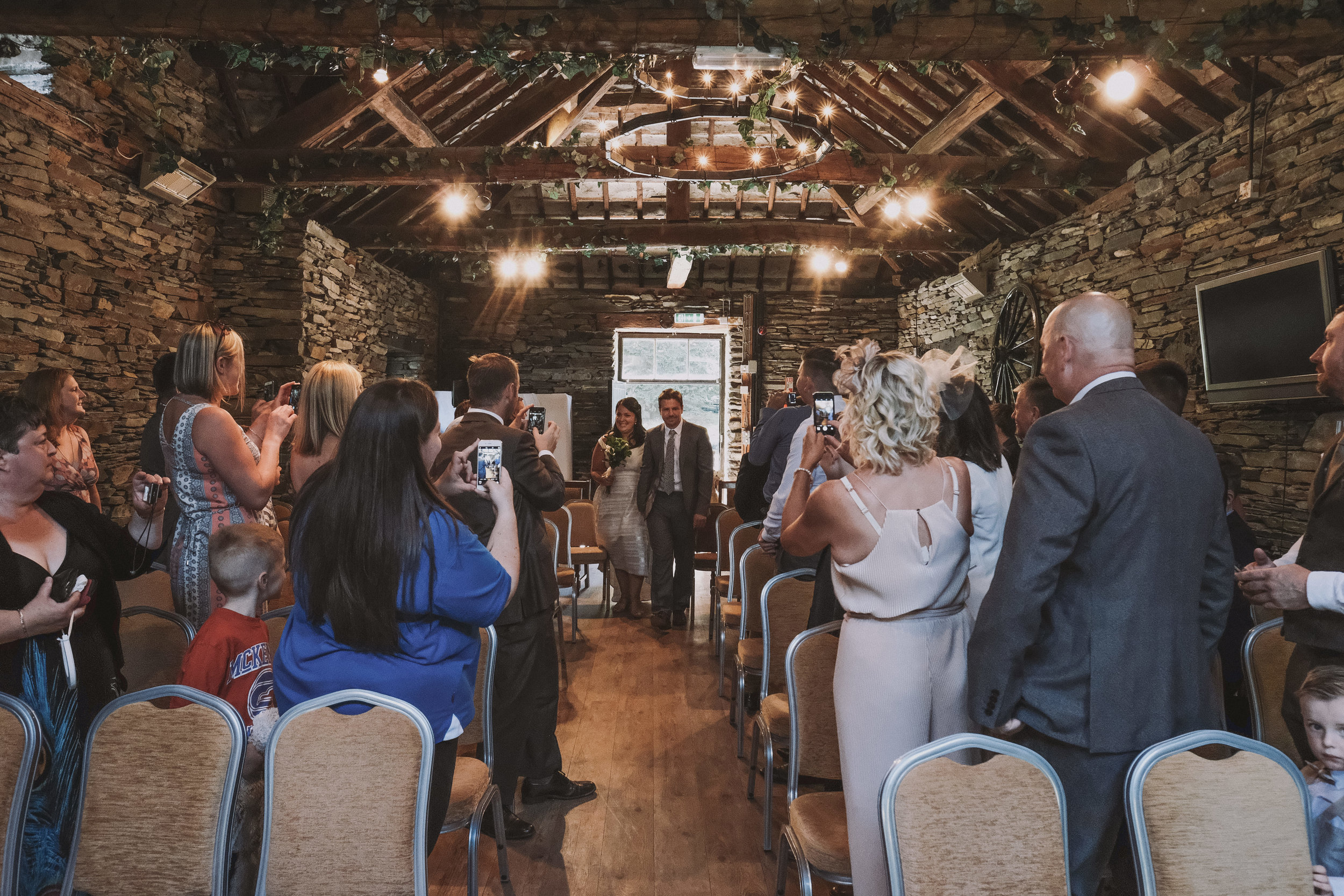 The entrance of the bride and groom at Julia and Darren's Lake District wedding by Barry Forshaw