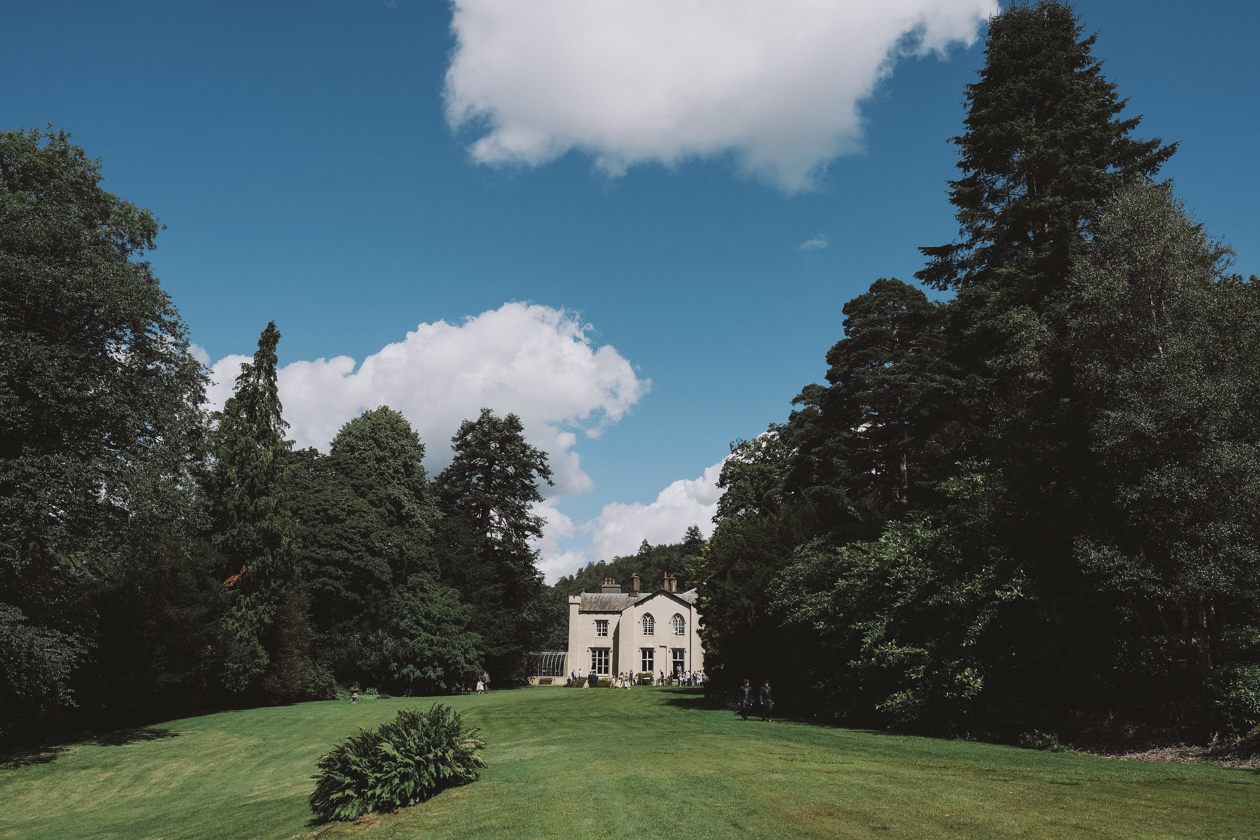 Monk Coniston Hall nestled amongst the trees at Julia and Darren's Lake District wedding by Barry Forshaw