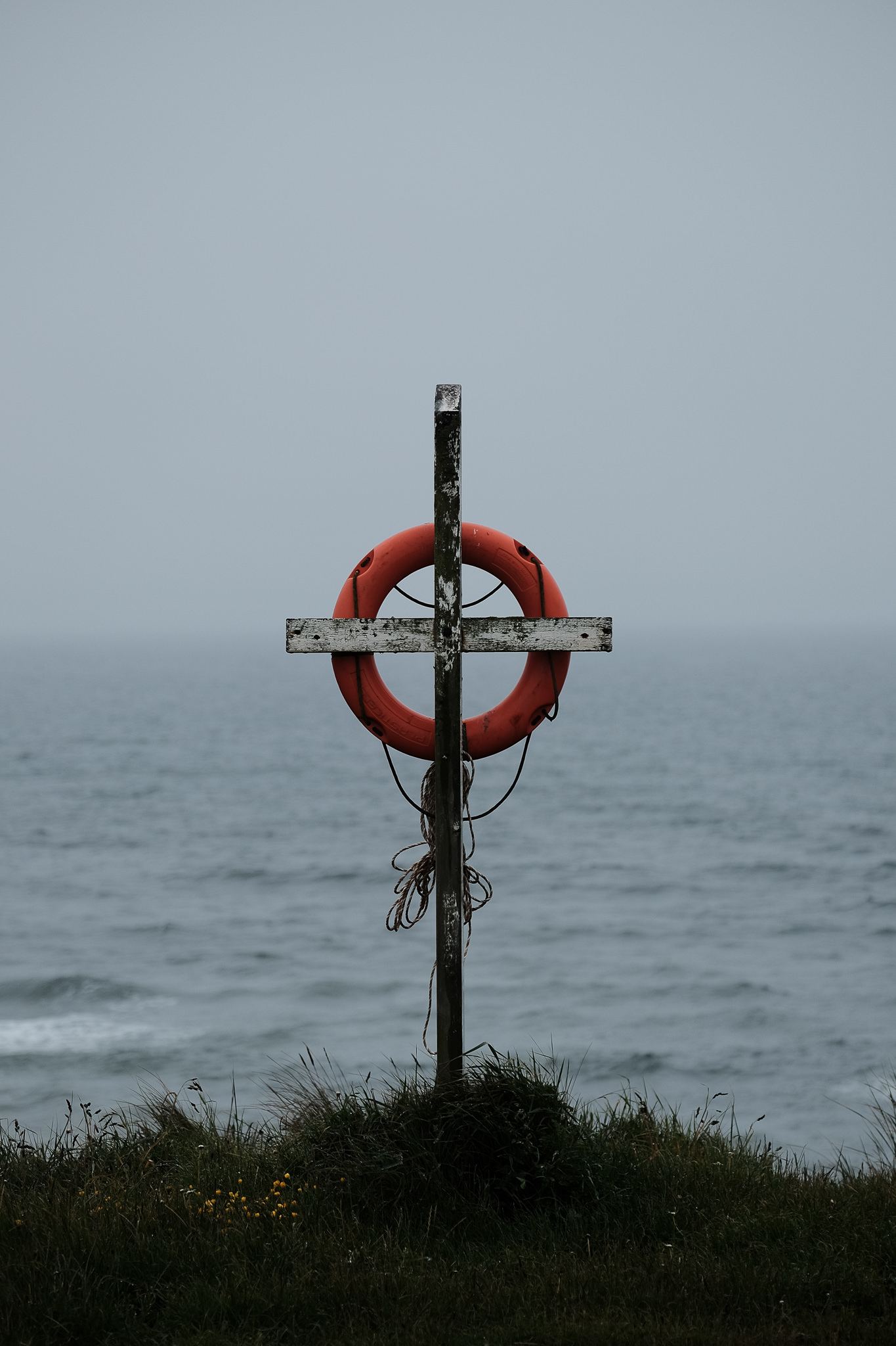 A life preserver with a stormy sea behind on the northumberland coast