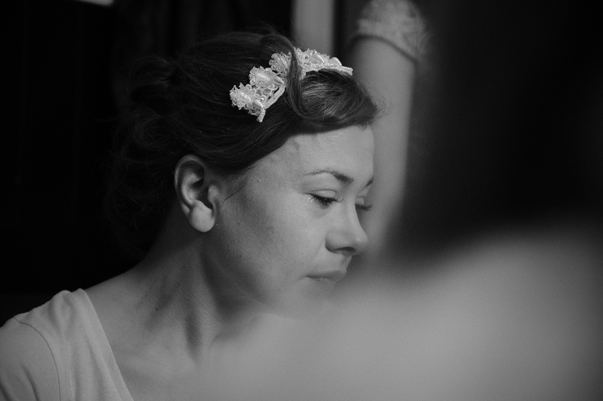Black and white photo of the bride crying before her wedding in Northumberland